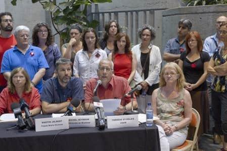 Quelques centaines de professeurs ont dénoncé la loi 12, l'ancien projet de loi 78, lors d'une conférence de presse à l'UQAM aujourd'hui.