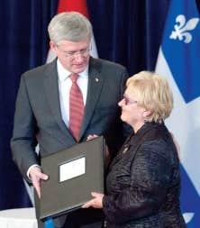 La mairesse de Lac-Mégantic, Colette Roy-Laroche, a salué l'aide financière fédérale annoncée par Stephen Harper.