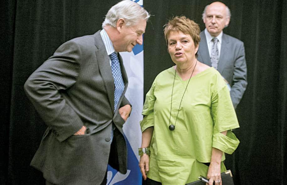Serge Ménard et ses deux commissaires adjoints, l'ex-présidente de la CSN Claudette Carbonneau et l'ancien juge Bernard Grenier