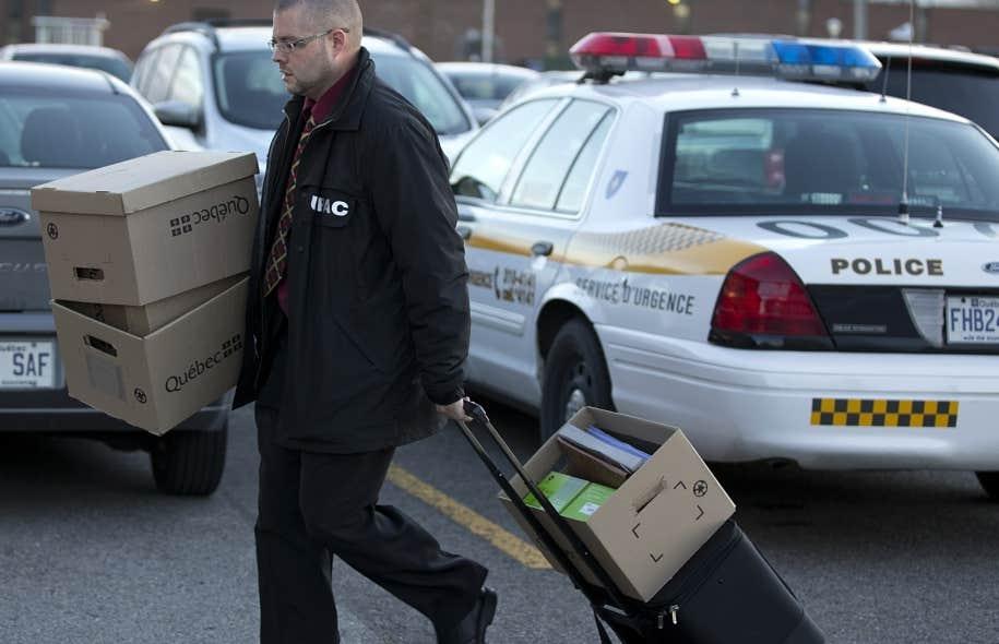 Les policiers de l'UPAC ont obtenu un mandat de perquisition pour saisir les données du serveur informatique à la permanence du PLQ à Montréal, en juin dernier.