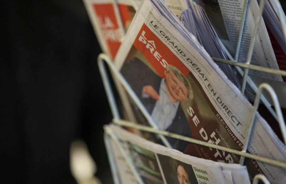 Dans la salle de rédaction de «La Presse», les compressions touchent les jeunes en particulier, les mises à pied se faisant par ancienneté.