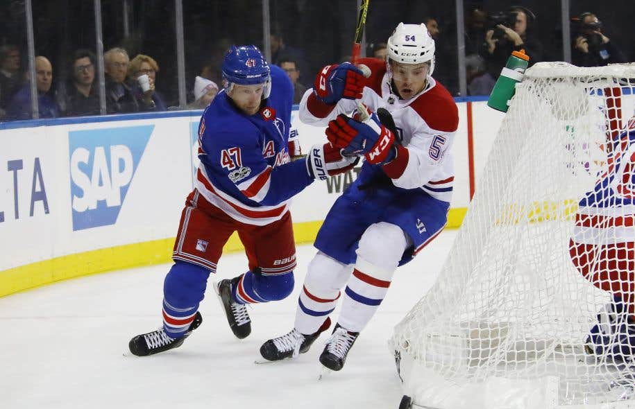 Steven Kampfer, #47 pour les Rangers de New-York, et Charles Hudon, #54 pour le Canadien de Montréal, lors du match opposant les deux formations, le 8 octobre dernier.