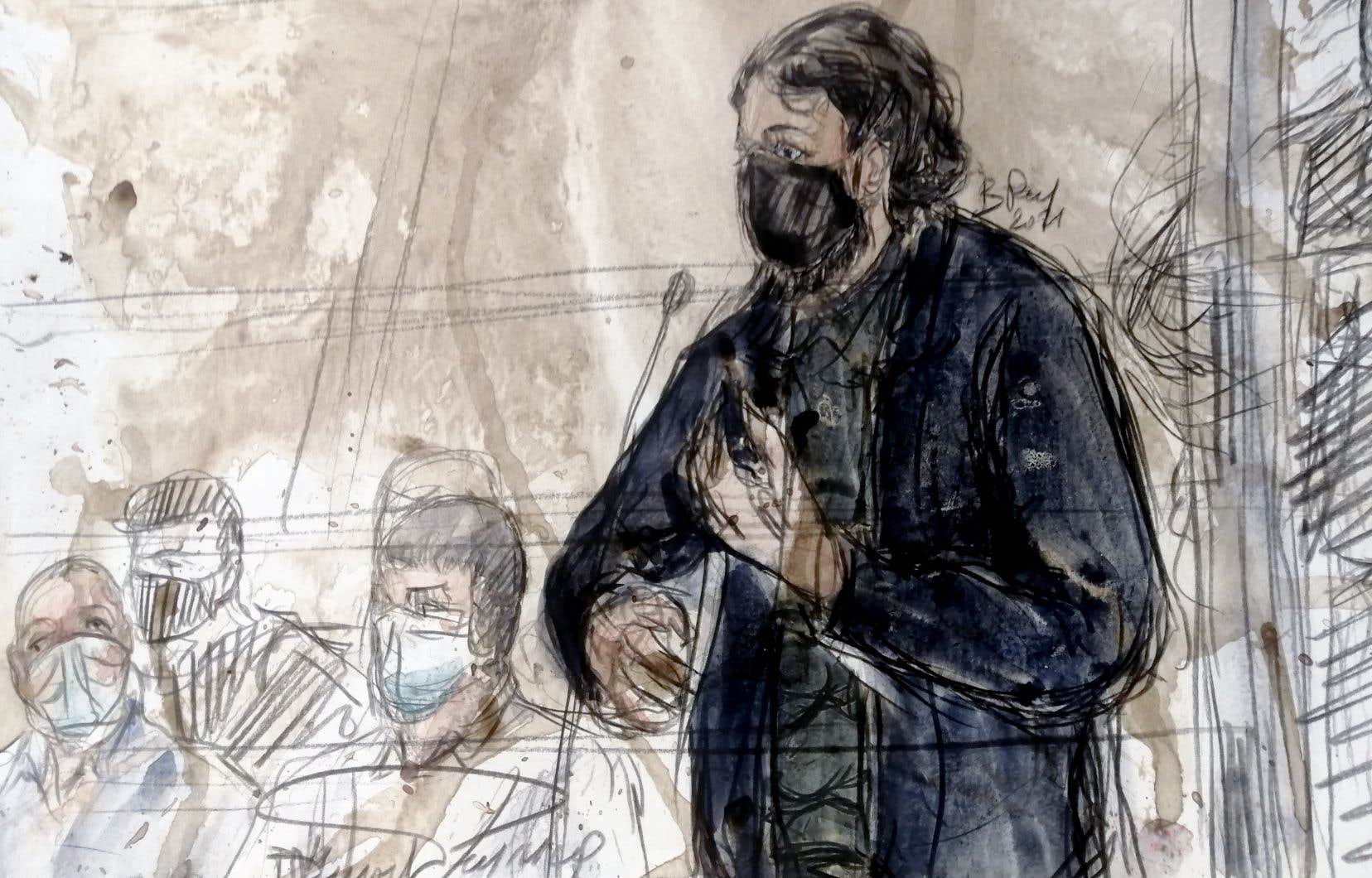 Croquis montrant (de gauche à droite) les coaccusés Mohamed Amri et Mohamed Abrini flanqués de Salah Abdeslam, le principal suspect des attentats de Paris du 13 novembre 2015, lors du procès des attentats de novembre 2015 à Paris