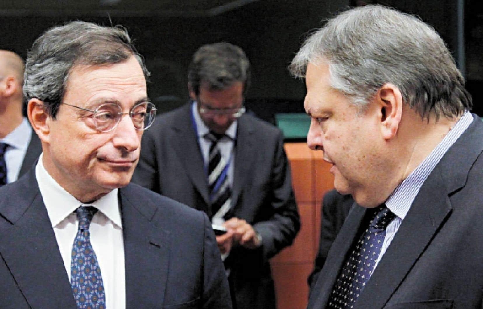 Le président de la Banque centrale européenne, Mario Draghi, en compagnie du ministre grec des Finances, Evangélos Vénizélos<br />