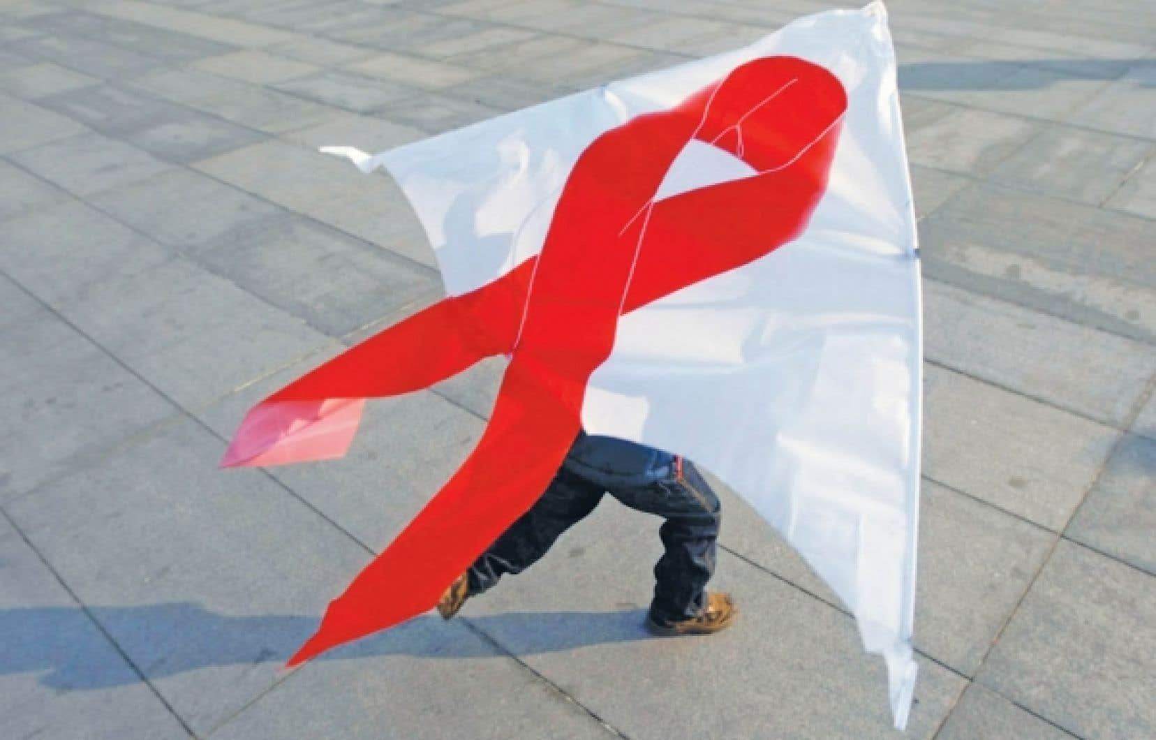&Agrave; P&eacute;kin, un enfant fait voler son cerf-volant au ruban rouge, symbole universel de la Journ&eacute;e mondiale de lutte contre le sida.&nbsp; <br />