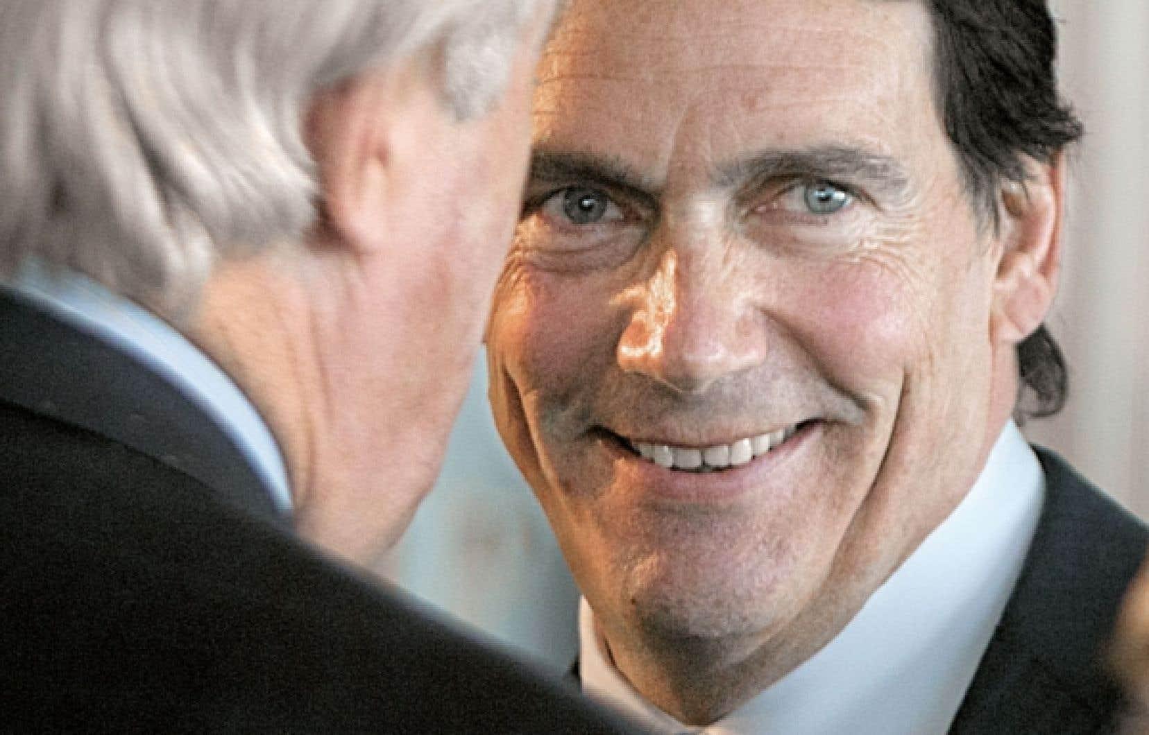 <div> Pierre Karl Péladeau tout sourire hier avec l'ancien premier ministre fédéral Brian Mulroney.</div>