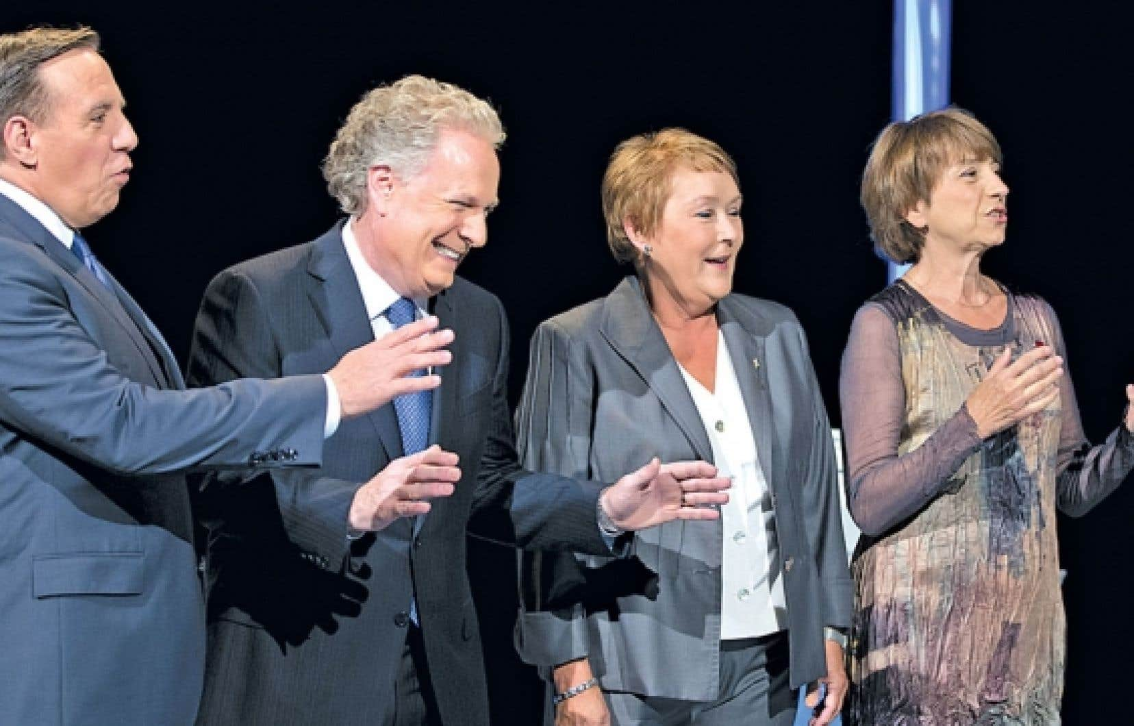 <div> François Legault, Jean Charest, Pauline Marois et Françoise David réunis avant de croiser le fer lors du premier débat télévisé de la campagne, lundi.</div>