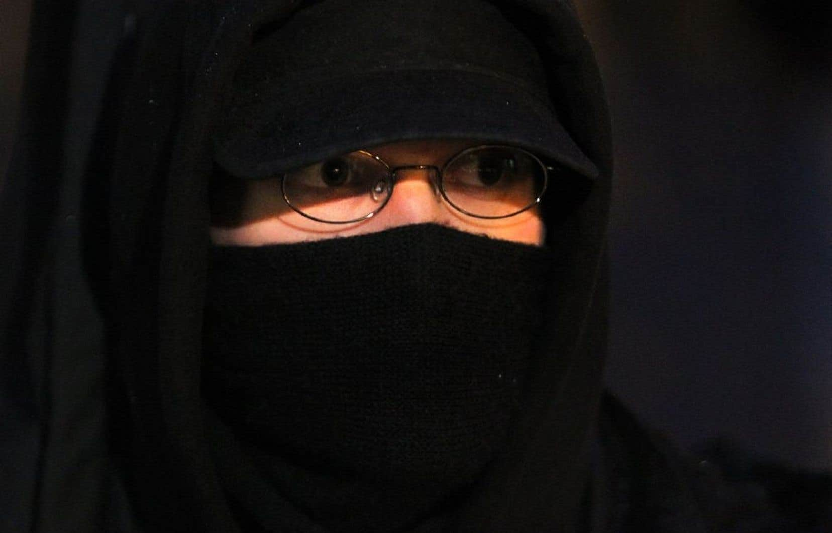 Une femme pourra conserver son niqab mais seulement dans certaines situations. (Photo d&#39;archives)<br />