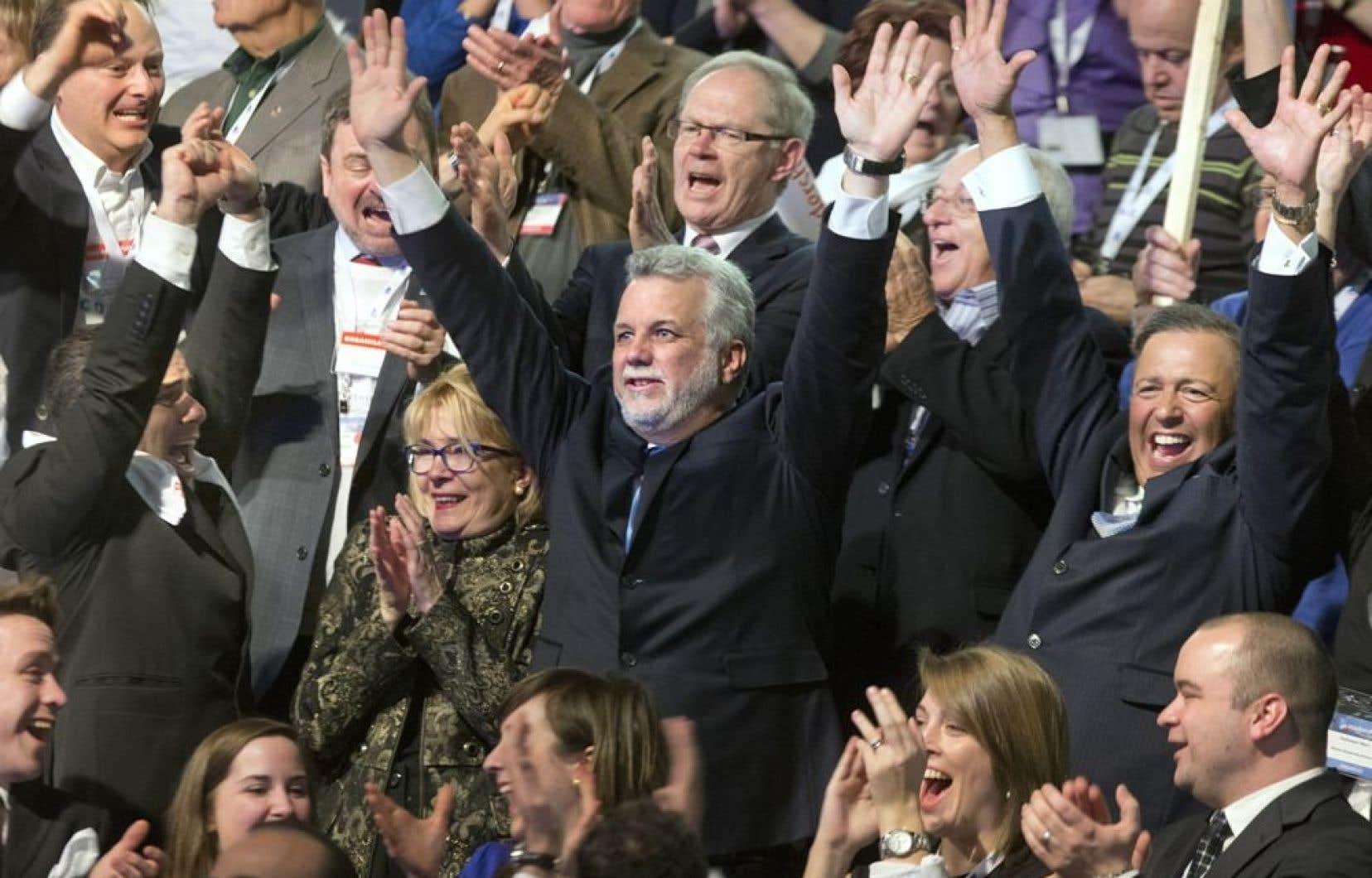 Le nouveau chef du Parti libéral du Québec, Philippe Couillard, savourant sa victoire.