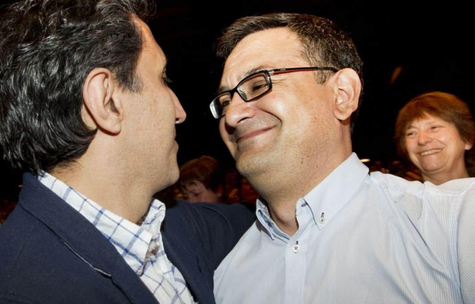 Le député Amir Khadir, le nouveau président et porte-parole de Québec solidaire, Andrés Fontecilla, et la porte-parole parlementaire, Françoise David.