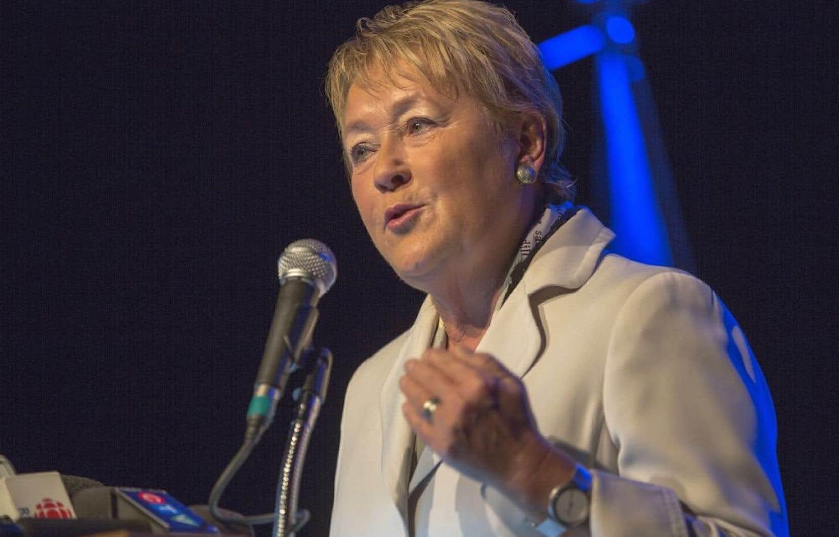 La première ministre a ajouté qu'elle appuyait les «orientations» de l'organisme québécois qui a soulevé la controverse au pays avec sa décision de bannir le port du turban, de patka ou de keski par les jeunes joueurs.