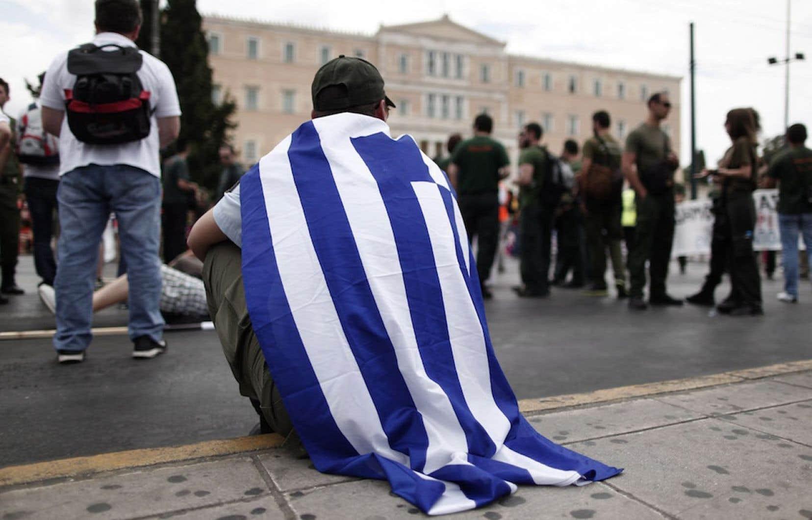 Le peloton des pays affichant un endettement public supérieur à 100 % de leur PIB est mené par la Grèce. Sur la photo, une manifestation contre les mesures d'austérité s'est tenue la semaine dernière à Athènes.