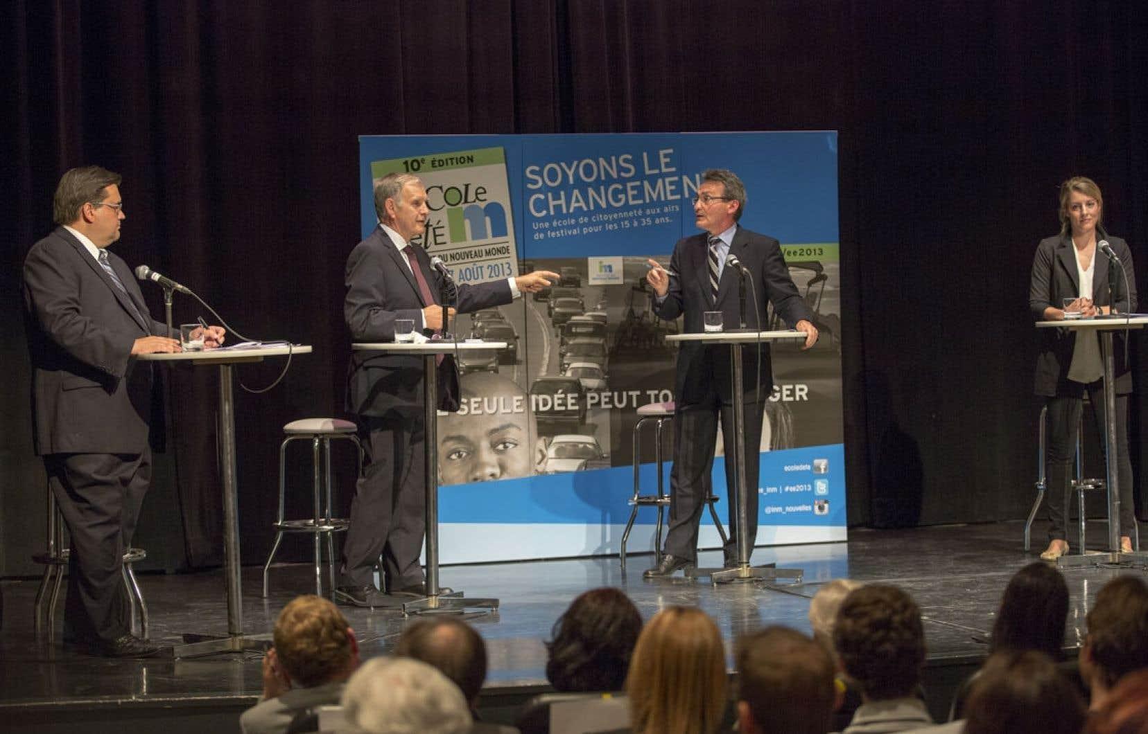 De gauche à droite: Denis Coderre, Marcel Côté, Richard Bergeron et Mélanie Joly vendredi lors de leur premier débat.