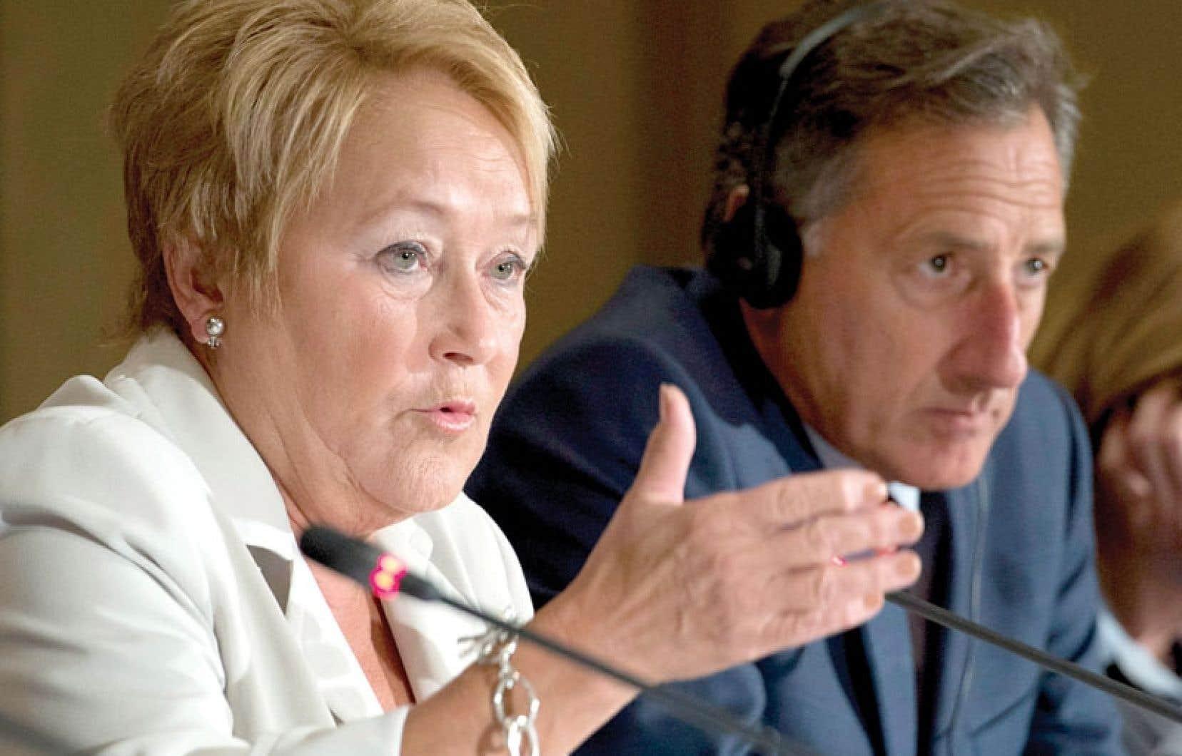 Pauline Marois, en compagnie du gouverneur du Vermont, Peter Shumlin. Ce dernier s'est personnellement engagé à porter la résolution au président américain, Barack Obama.