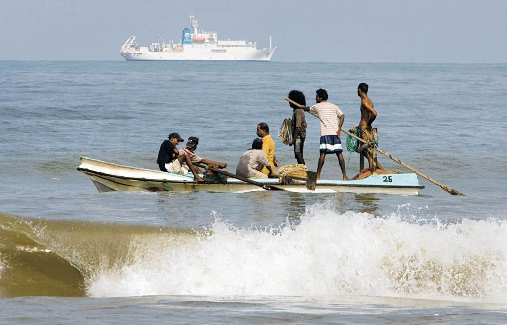 D'ici le milieu du siècle, la demande mondiale en énergie doublera. Ici, huile de bras contre mazout au Sri Lanka.