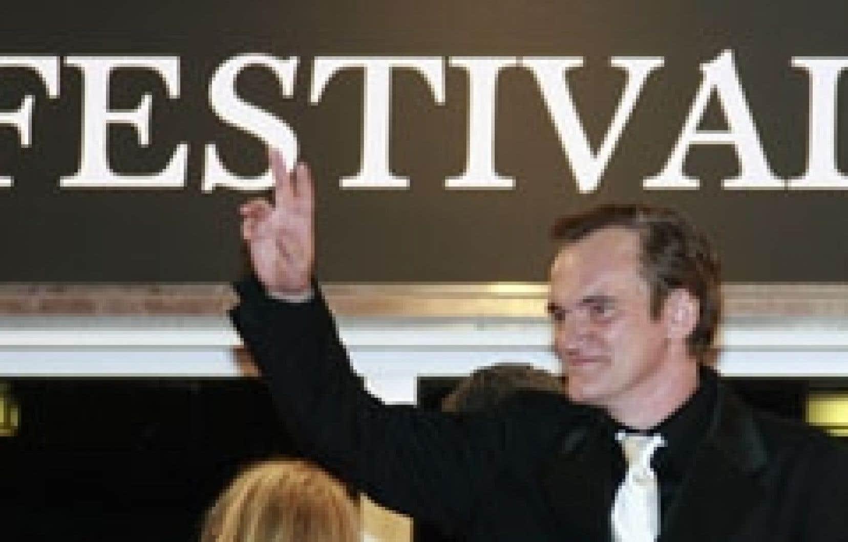 Treize ans après sa Palme d'or pour Pulp Fiction, Quentin Tarantino a amusé Cannes avec Grindhouse, exercice de style et pastiche des films d'exploitation des années 70.
