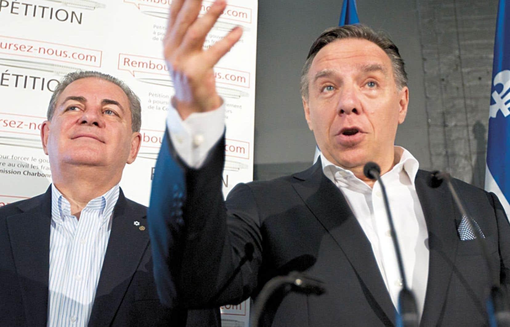 L'arrivée de Jacques Duchesneau (à gauche) en début de campagne a permis au parti dirigé par François Legault de chauffer le PQ et le PLQ aux dernières élections.