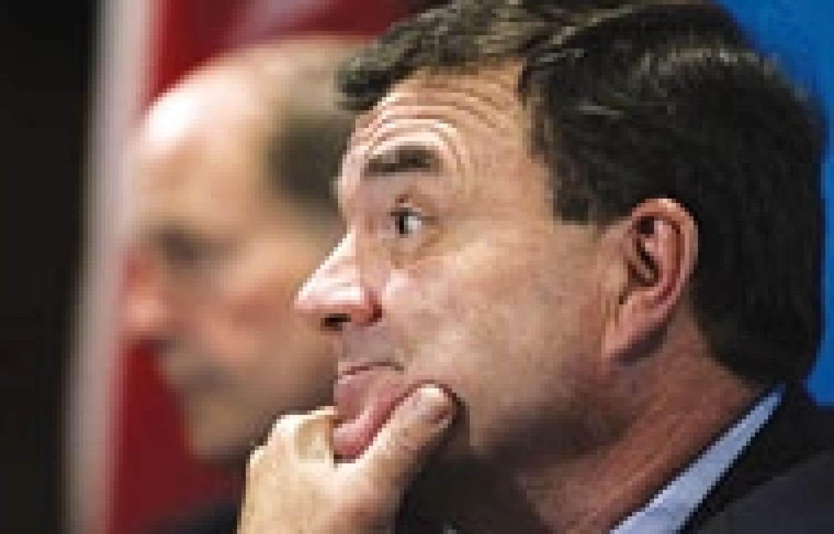 Le ministre des Finances, Jim Flaherty, a présenté un excédent budgétaire de 840 millions pour juillet 2006.