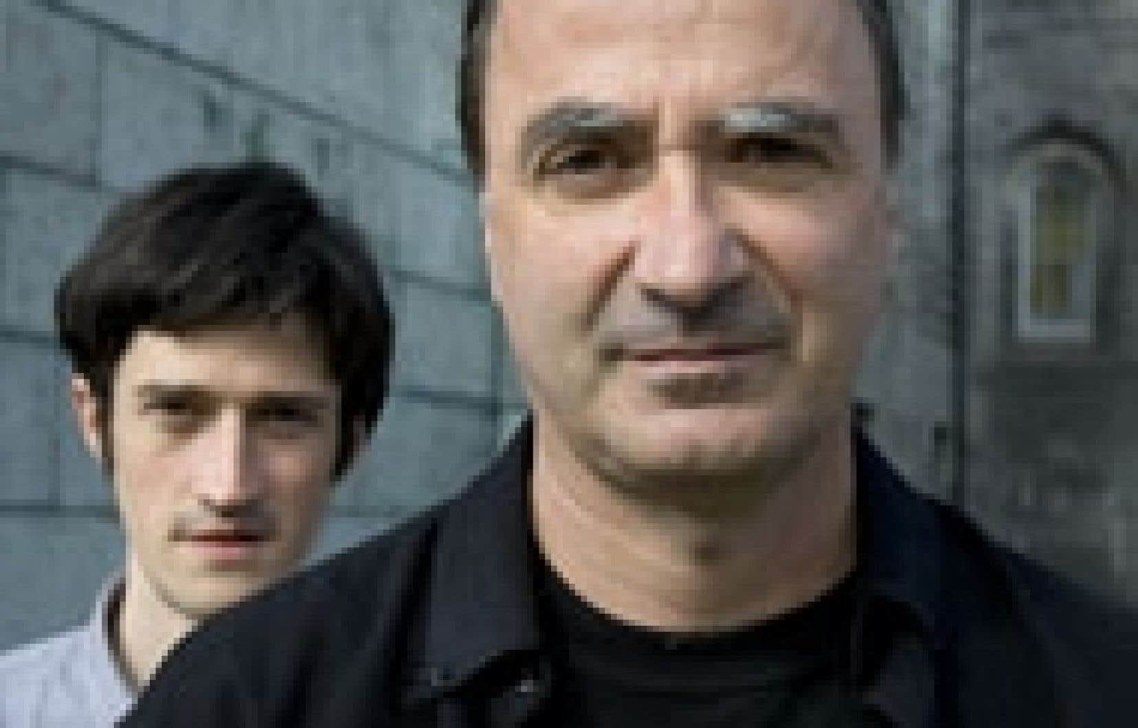 Michel Faubert, à l'avant plan, et Jérôme Minière.
