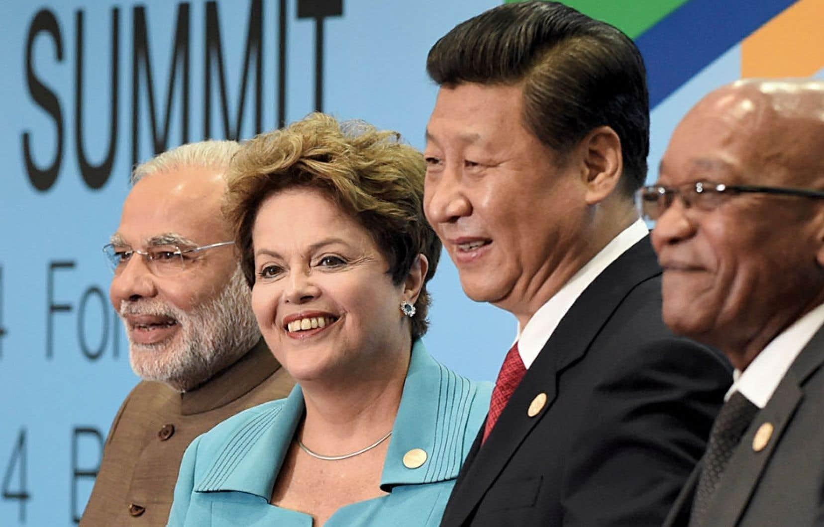 À la réunion des Brics mardi à la station balnéaire de Fortaleza, de gauche à droite: le premier ministre indien, Narendra Modi, la présidente brésilienne, Dilma Rousseff, et ses homologues chinois Xi Jinping et sud-africain Jacob Zuma.
