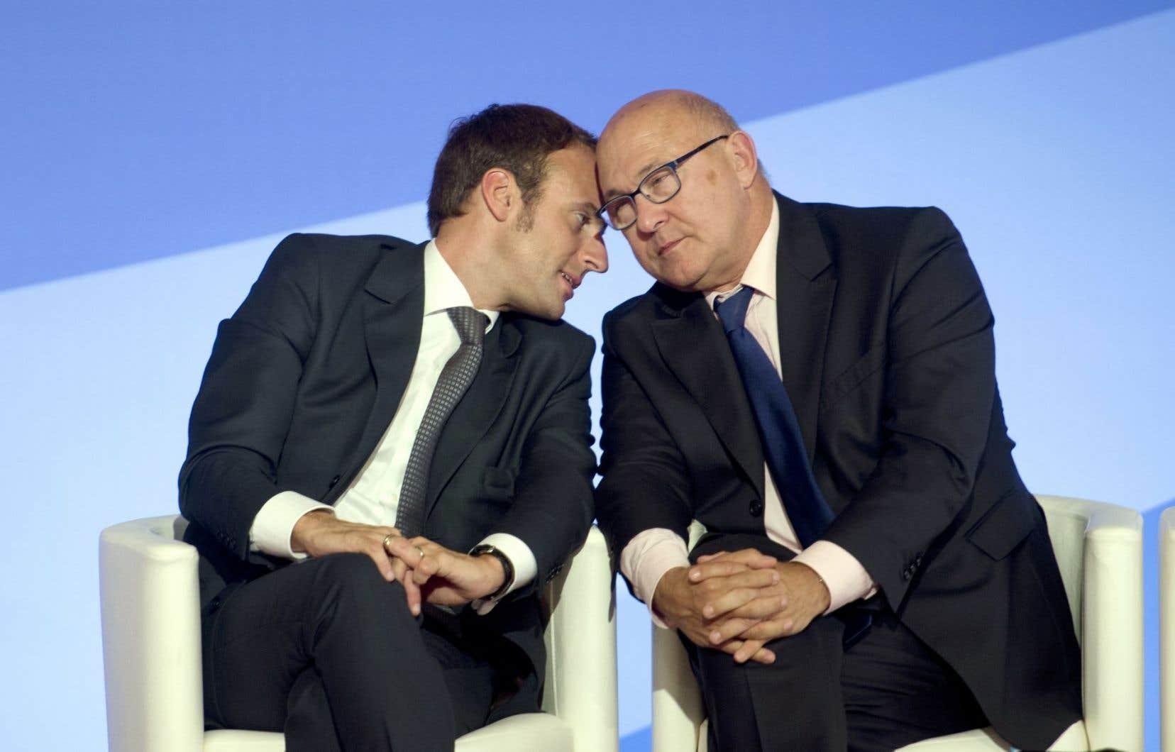 Échange de confidences entre le ministre français de l'Économie et de l'industrie, Emmanuel Macron, et son collègue des Finances, Michel Sapin, durant un colloque sur le financement et l'investissement qui avait lieu lundi. L'économie de l'euro, notamment celle de la France, continue de faire du sur-place.