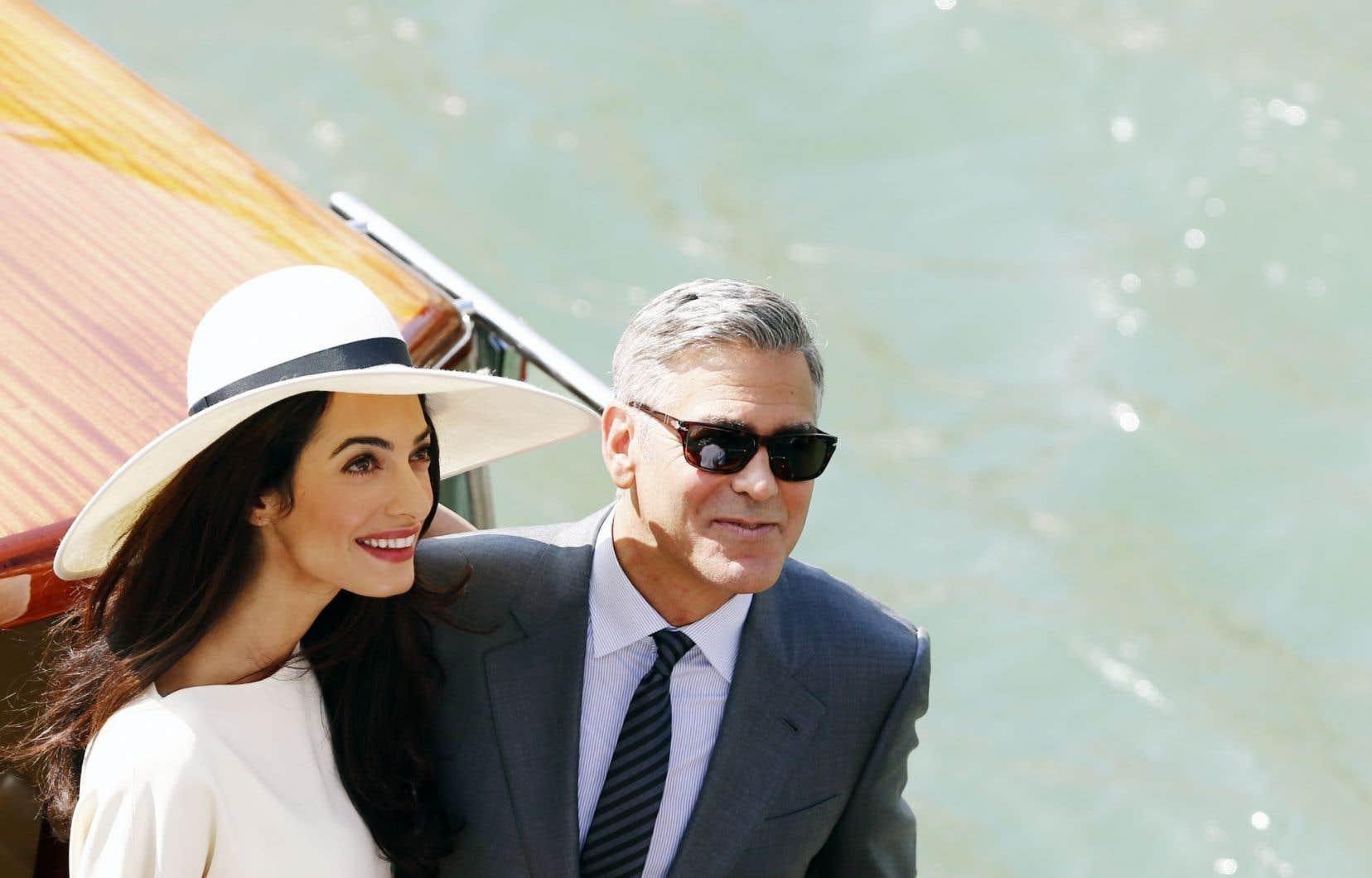 Amal Alamuddin en compagnie de son nouvel époux, l'acteur George Clooney, la fin de semaine dernière lors de leur mariage à Venise. Le démon du midi peut prendre des allures de conte de fées.