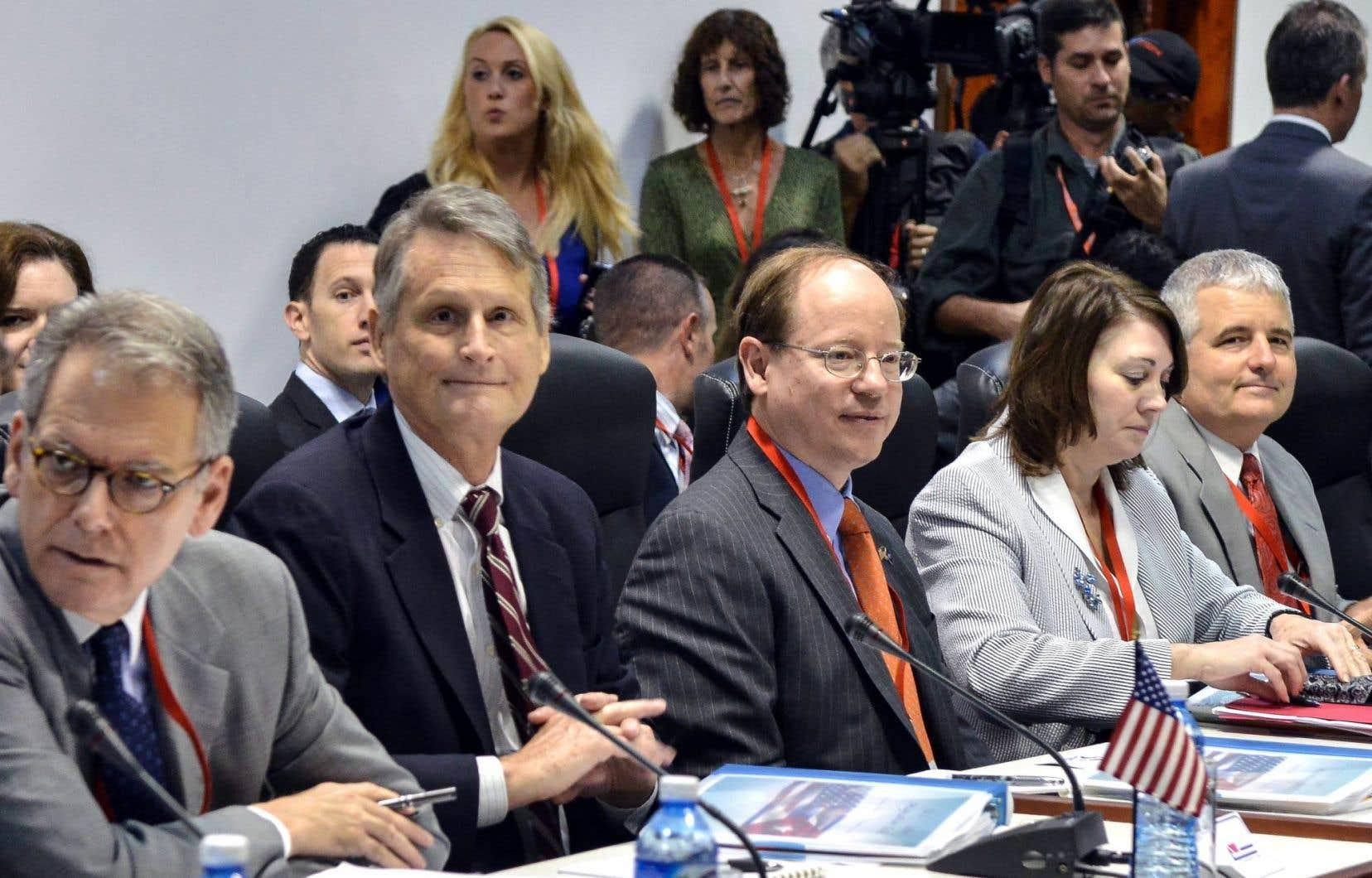 Les membres de la délégation américaine étaient tout sourire au début des discussions mercredi.