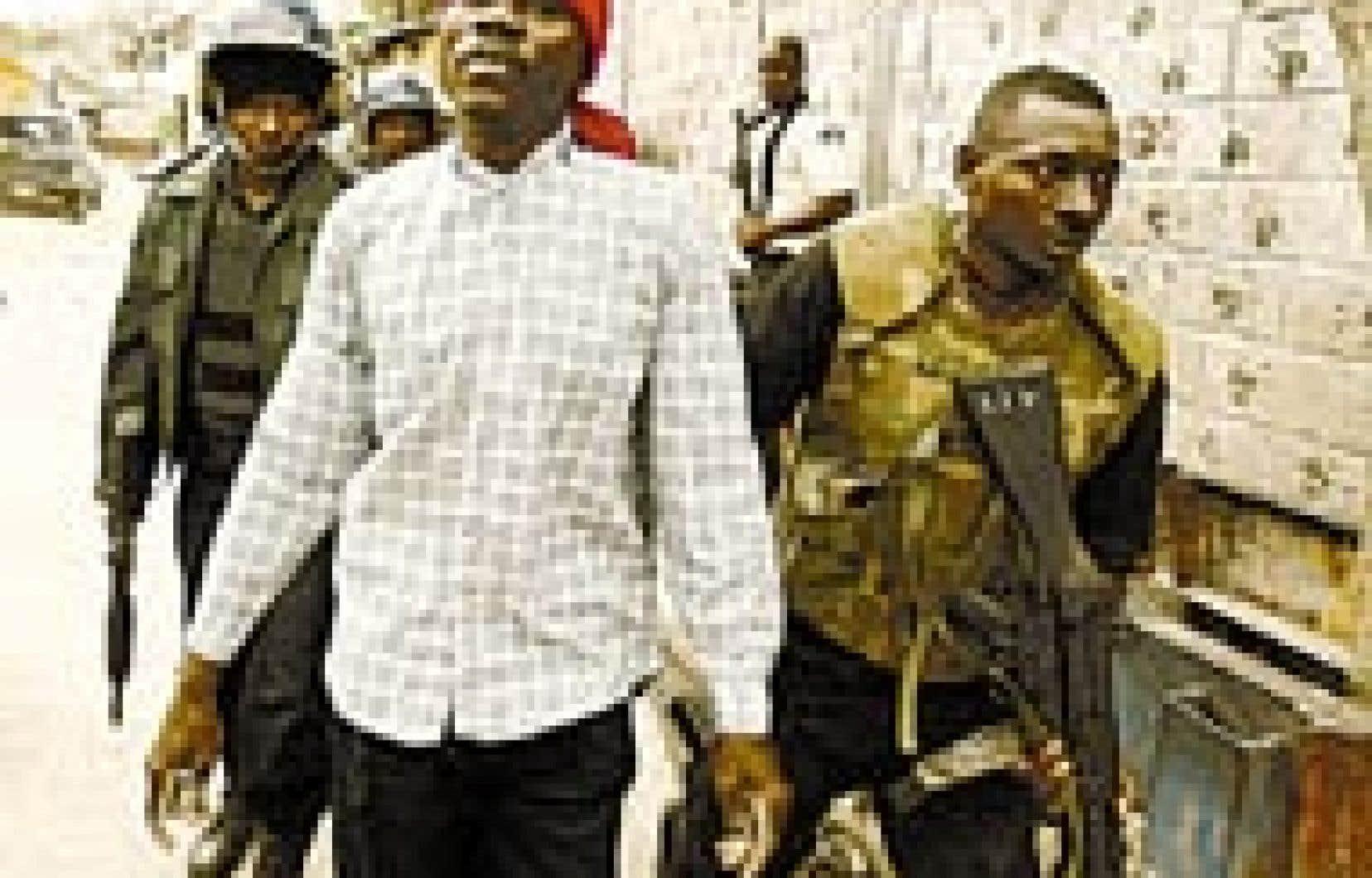 Des policiers haïtiens arrêtent un étudiant soupçonné d'avoir lancé une pierre au cours de la manifestation organisée hier à Port-au-Prince.