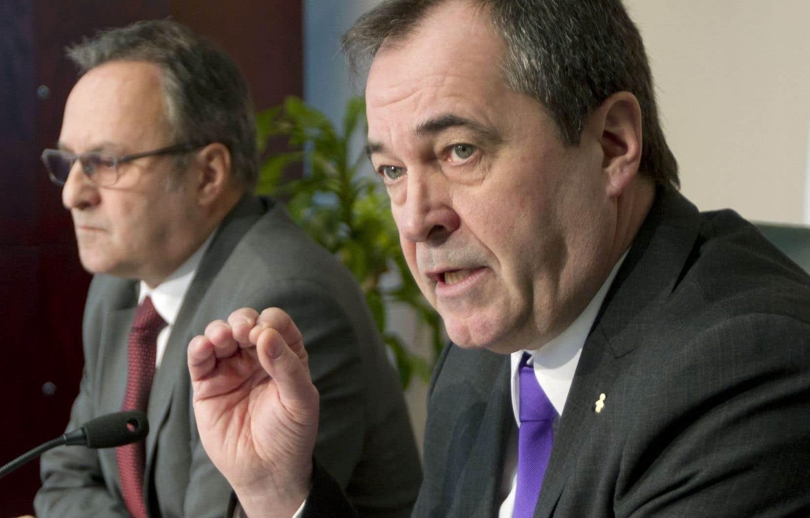 À gauche, le président de la FTQ, Daniel Boyer, à droite, Serge Cadieux, le secrétaire général de la fédération