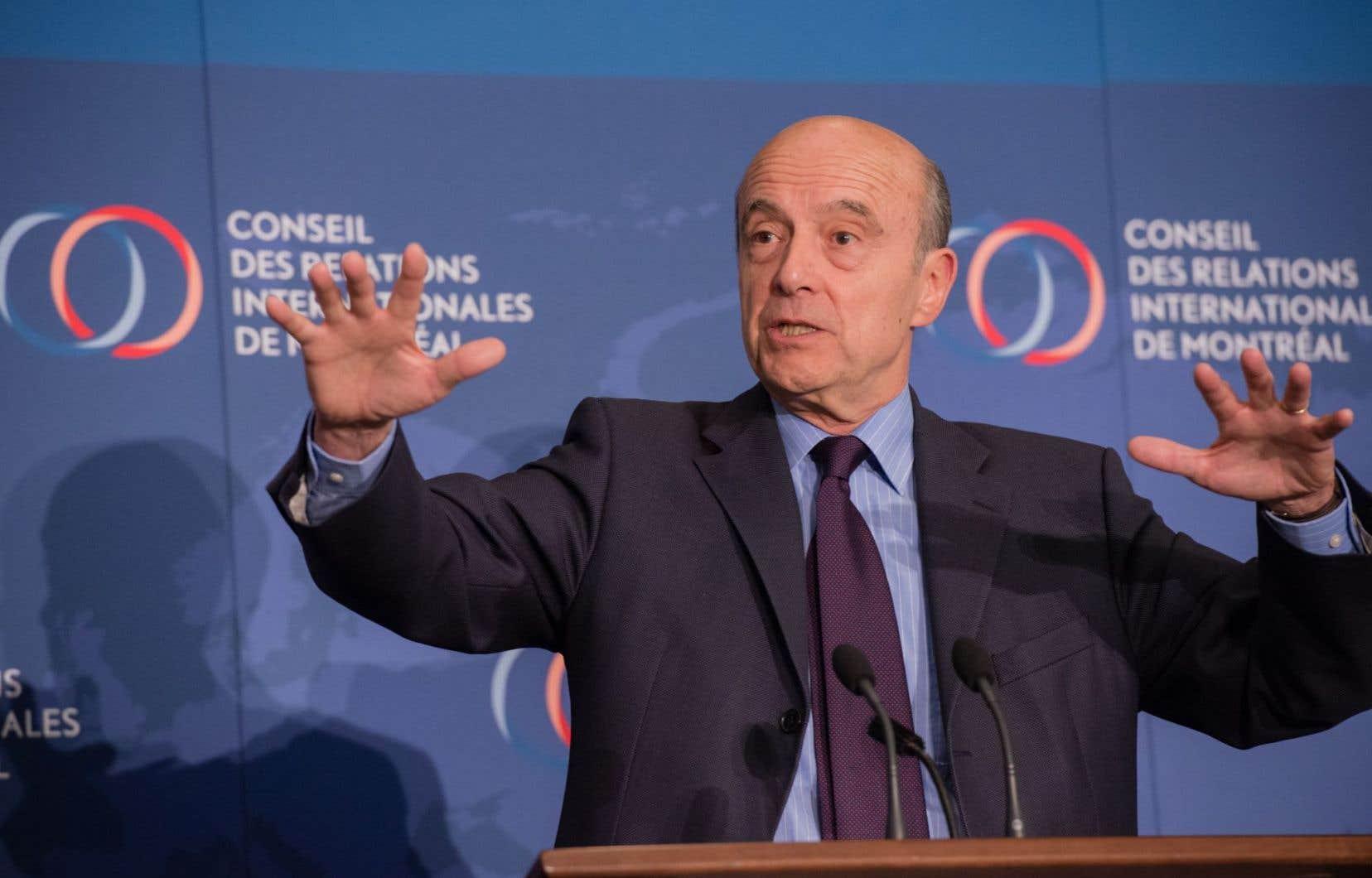 Le politicien français Alain Juppé, à Montréal mercredi, a assisté à une conférence devant le Conseil des relations internationales de Montréal (CORIM).