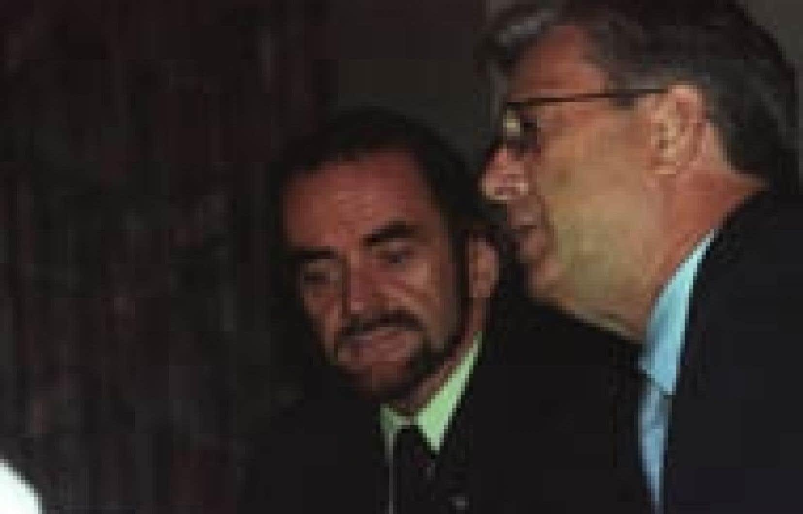 Michel Nadeau, à gauche, photographié l'an dernier en compagnie de son ex-patron, Jean-Claude Scraire.