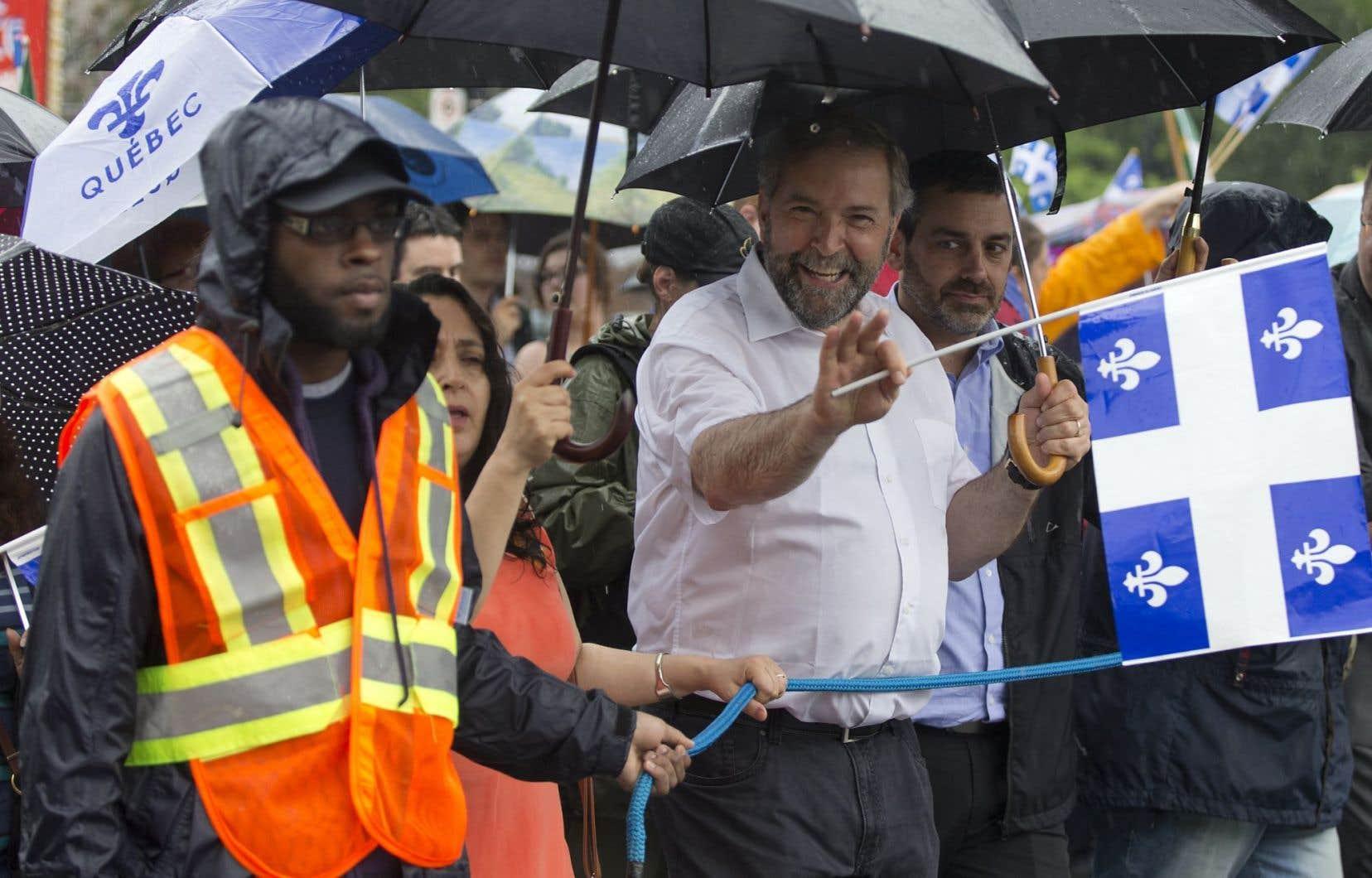 Thomas Mulcair, lors de la fête nationale, en 2014. La proposition néodémocrate reconnaissant une victoire référendaire de 50 % + 1 voix, indispose un comité spécial pour l'unité canadienne.