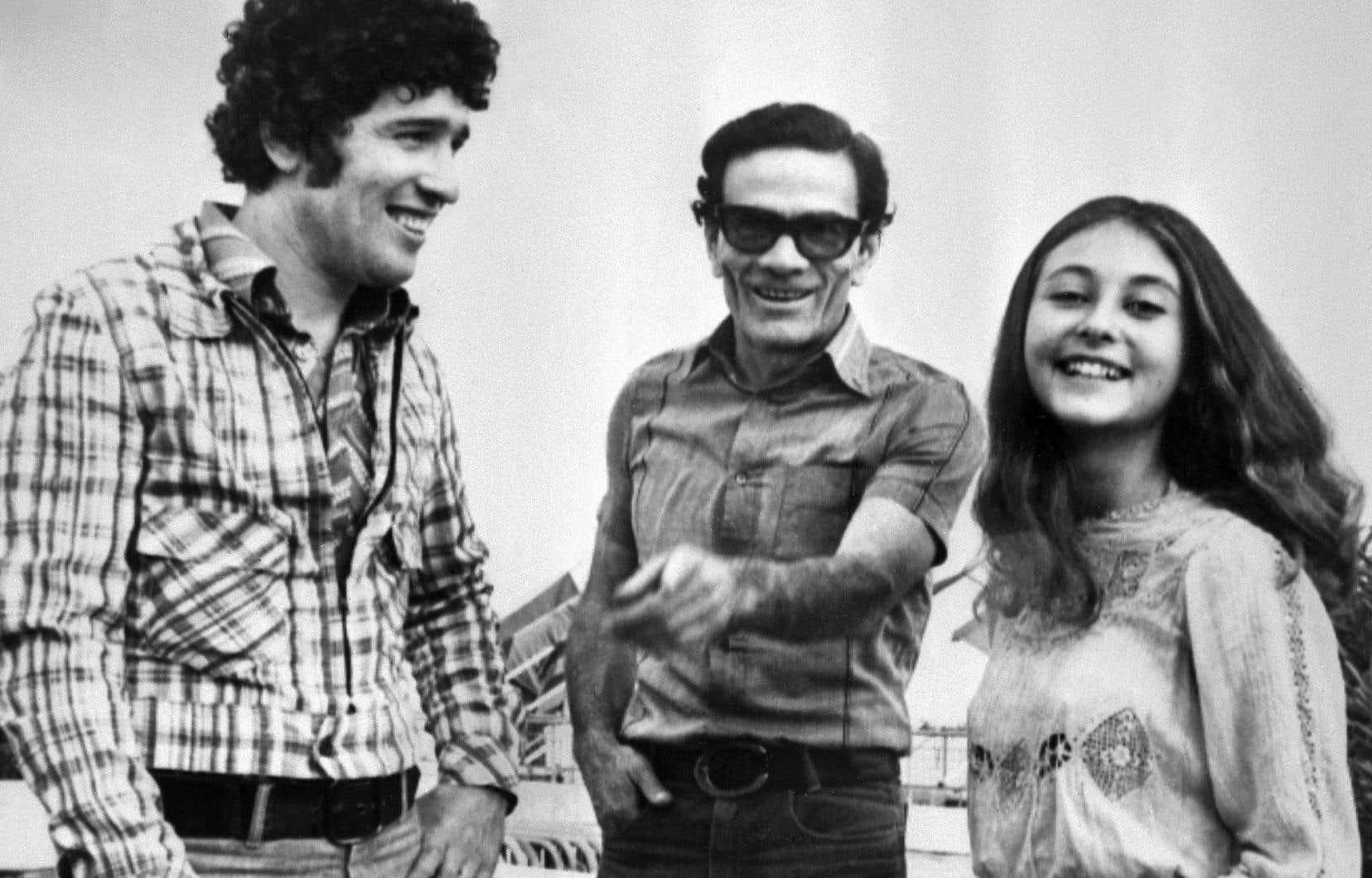 Pier Paolo Pasolini avec les acteurs principaux d'«Il fiore delle mille e una notte», Ninetto Davoli et Tessa Bouchet, au Festival de Cannes en 1974.