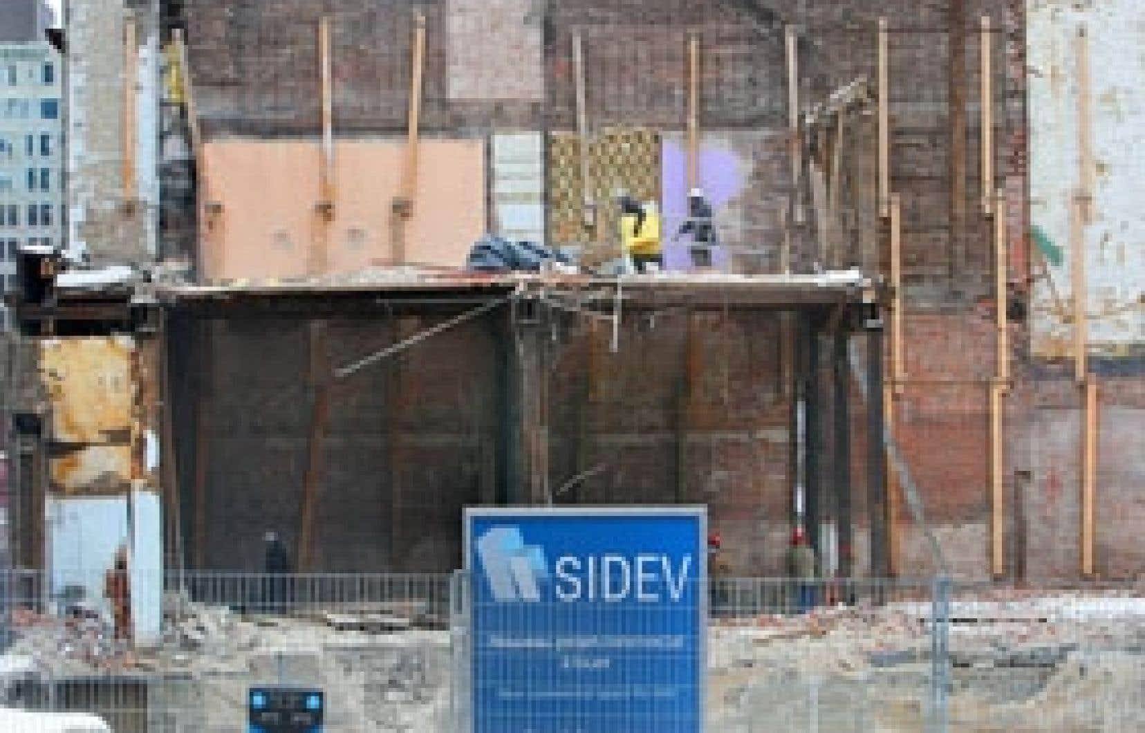 La société immobilière SIDEV a fait démolir six immeubles, dont la salle du Spectrum, pour mettre en chantier un projet commercial aujourd'hui menacé.
