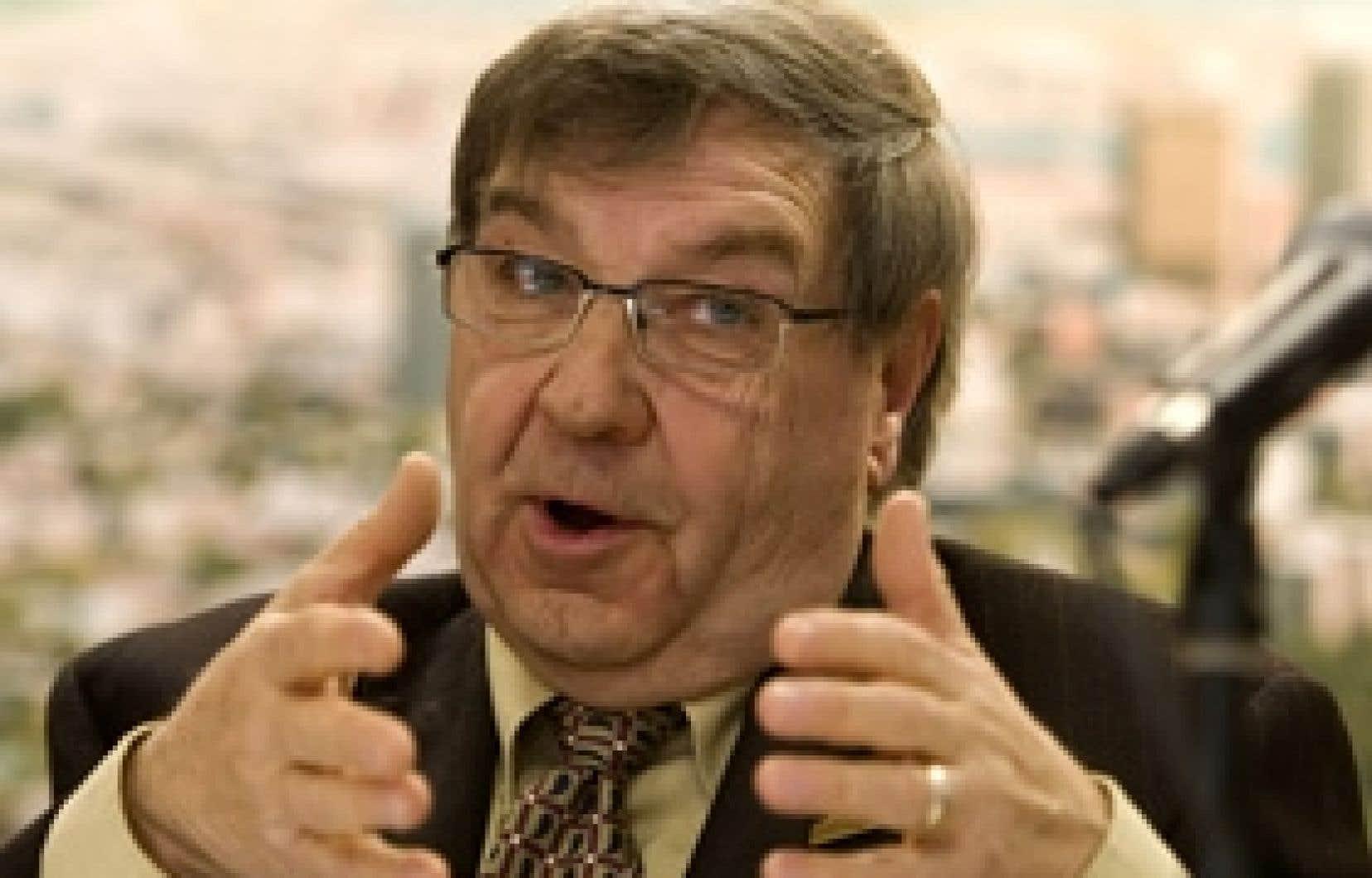 Le président de la Commission des champs de bataille nationaux, André Juneau