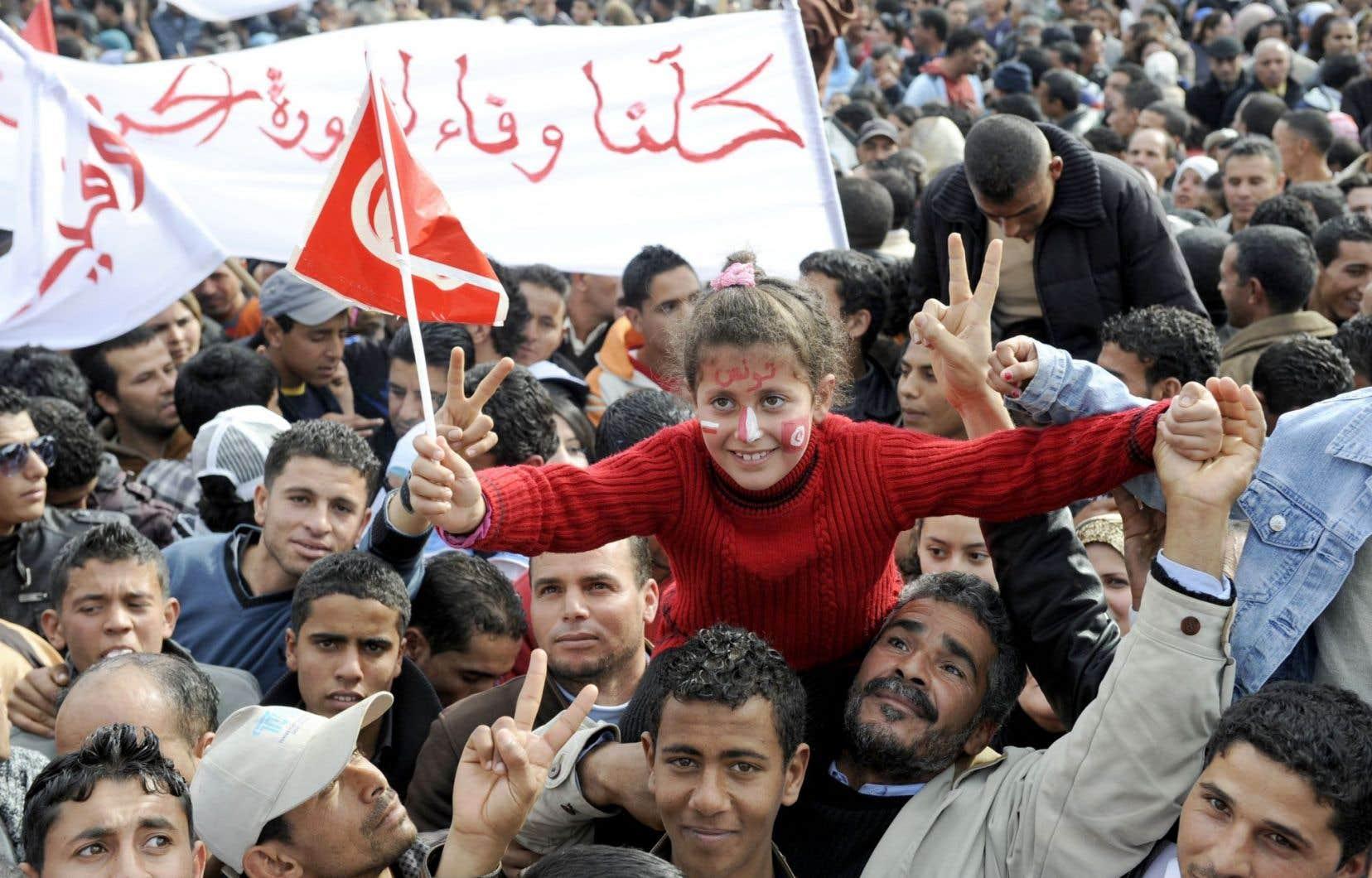 Tunis, décembre2011. Dans les rues de la capitale, les Tunisiens célèbrent le premier anniversaire du Printemps arabe.
