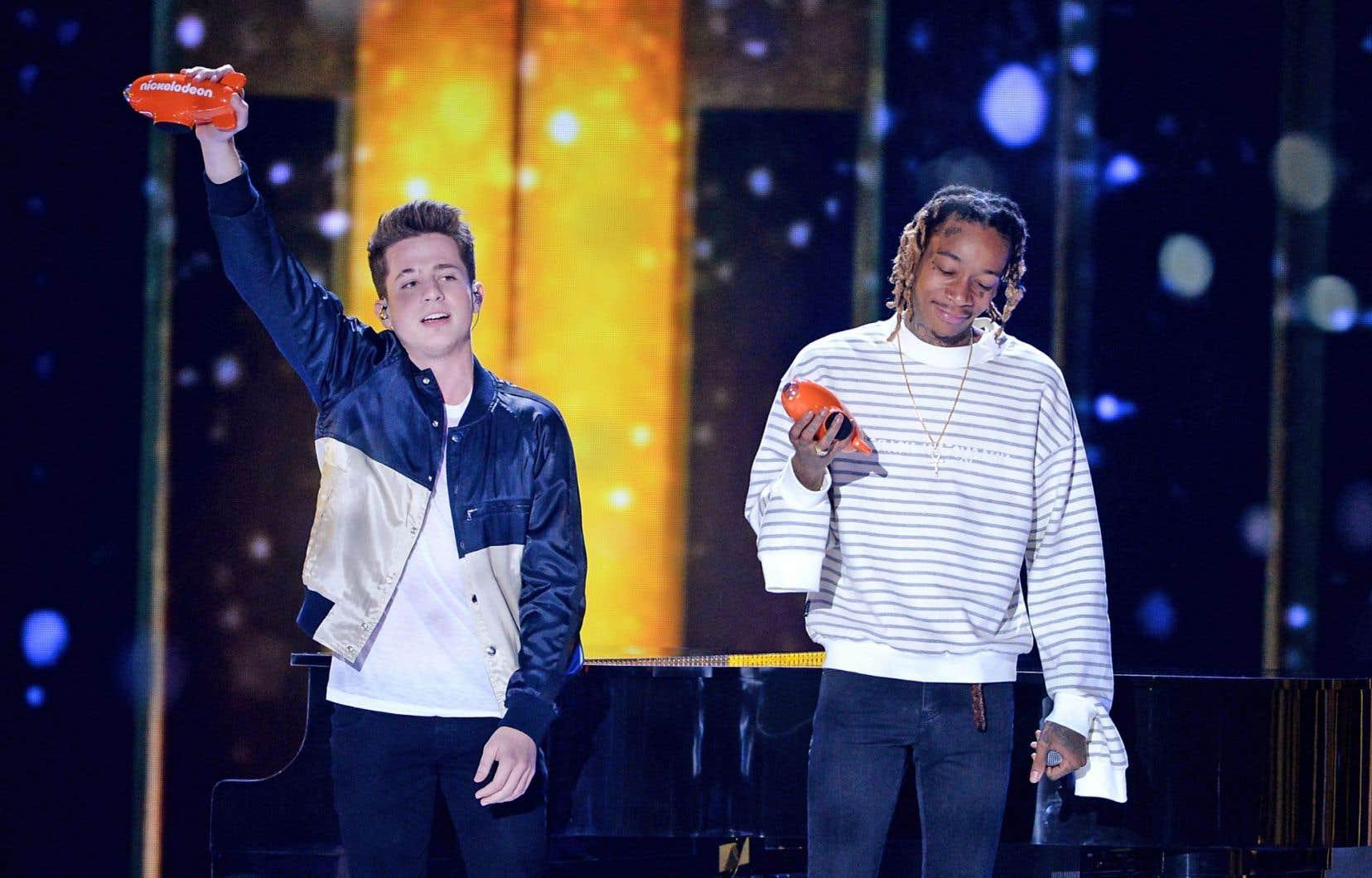 La pièce la plus vendue a été «See You Again» de Wiz Khalifa (à droite) avec Charlie Puth, dont 20,9millions d'exemplaires se sont écoulés.
