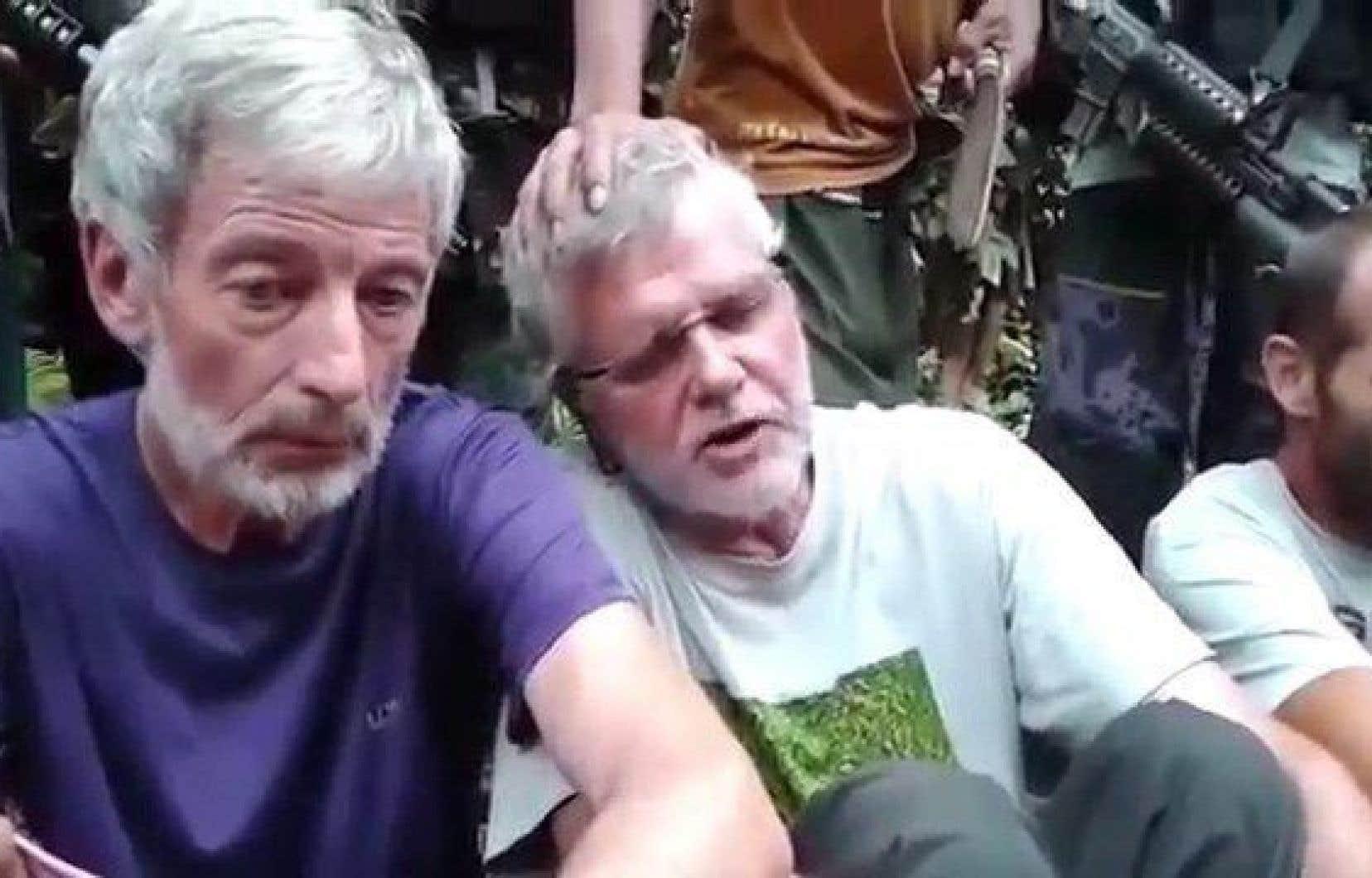 Les Canadiens Robert Hall (à gauche) et John Ridsdel ont été enlevés dans une station balnéaire du sud des Philippines.