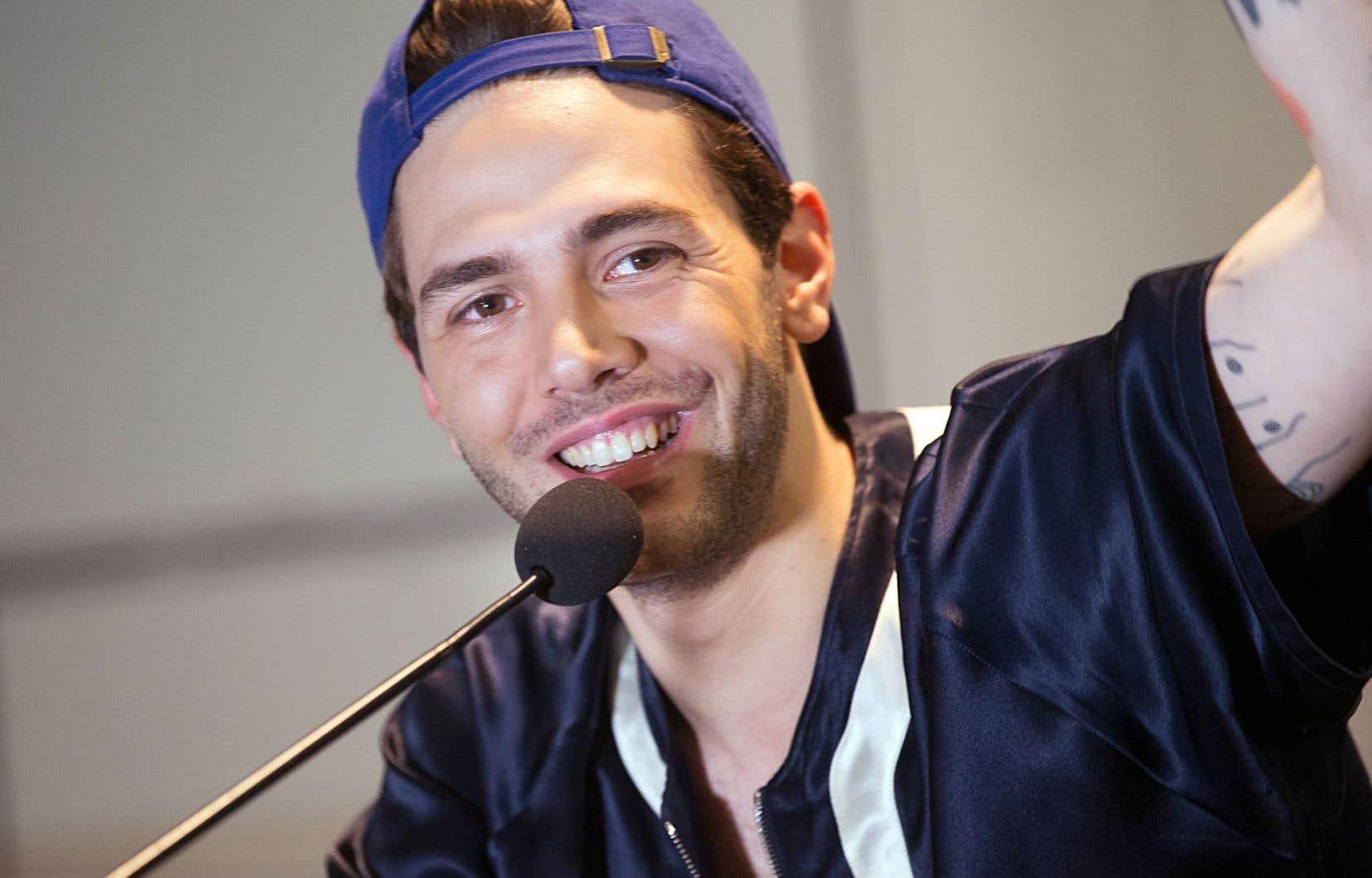 Le réalisateur québécois Xavier Dolan était de retour à Montréal lundi après-midi après un séjour cannois en montagnes russes.