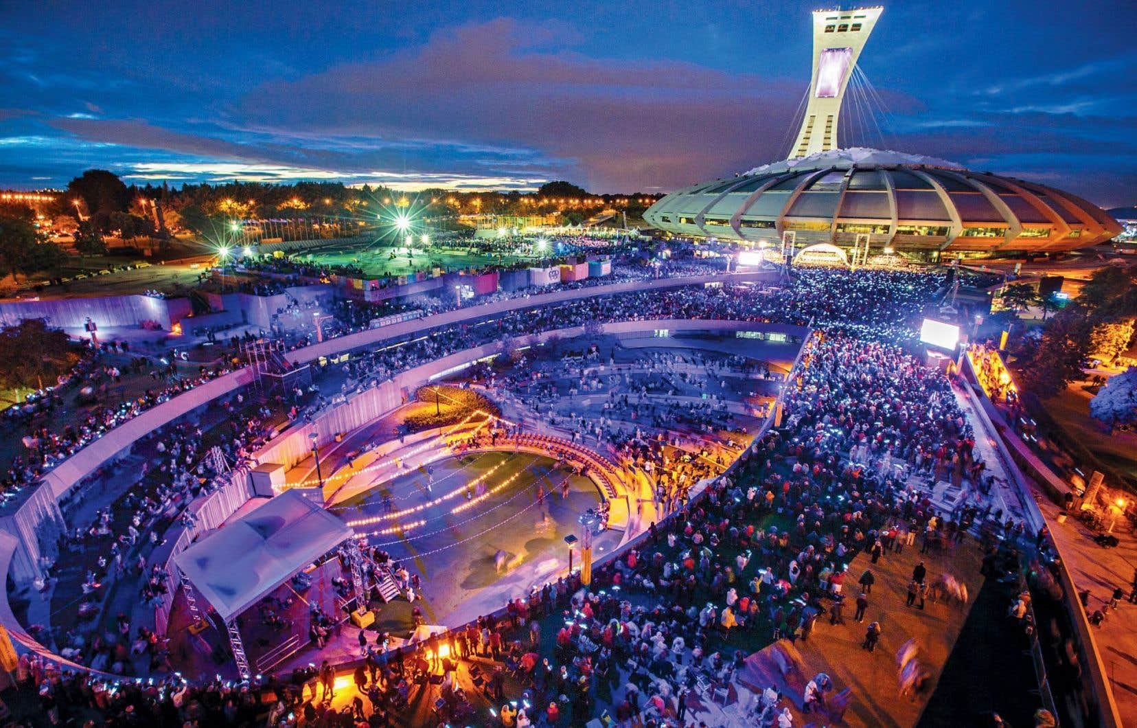 Kent Nagano et l'Orchestre symphonique de Montréal ont attiré 42 000 personnes lors d'un concert extérieur présenté sur l'esplanade du Parc olympique, en 2014. Aussi populaires soient-ils, ces événements ponctuels ne feraient pas grossir les rangs des adeptes des arts classiques.