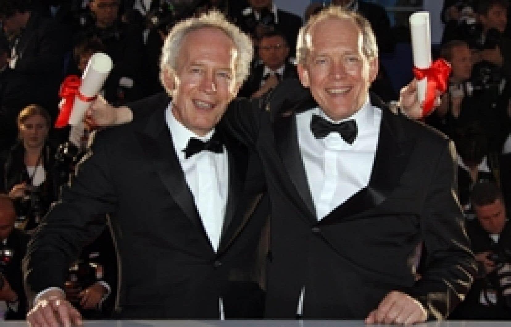 Les frères Luc et Jean-Pierre Dardenne recevant leur prix à Cannes le printemps dernier.