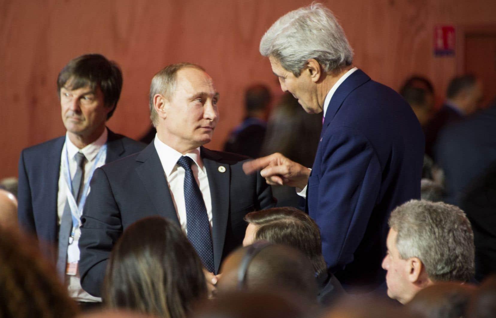 Archives - Le président russe Vladimir Poutine et le secrétaire d'État américain John Kerry.