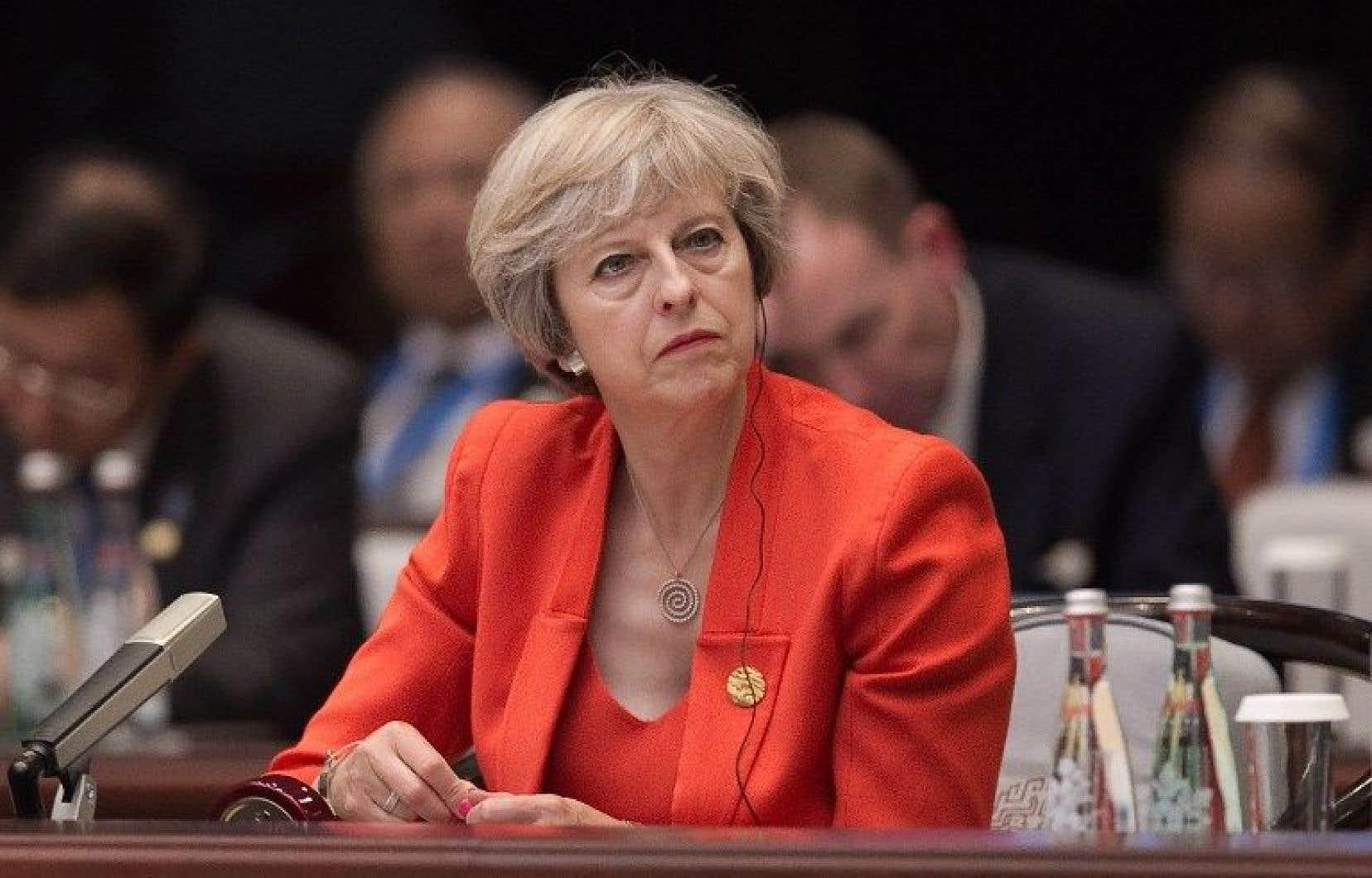 La première ministre conservatrice Theresa May aaffirmé vouloir faire du pays un «leader mondial du libre-échange».