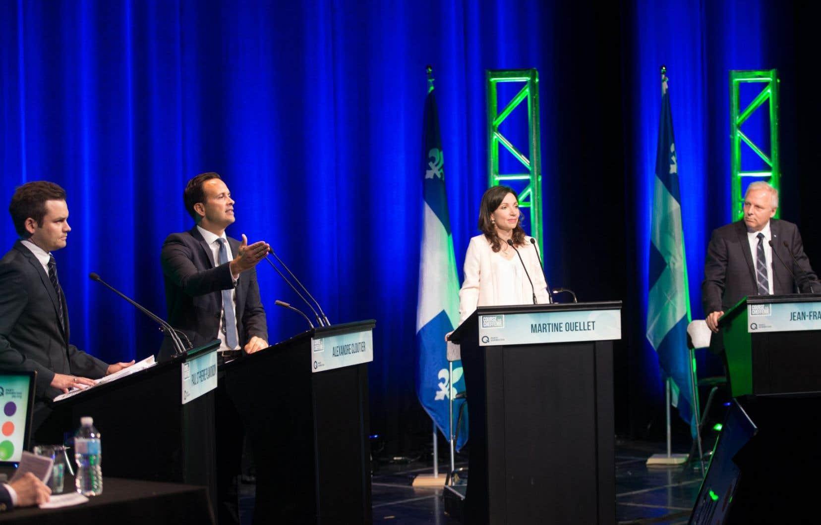 Les candidats à la chefferie du Parti québécois, Paul St-Pierre Plamondon, Alexandre Cloutier, Martine Ouellet et Jean-François Lisée, lors du débat du 25septembre dernier à Montréal