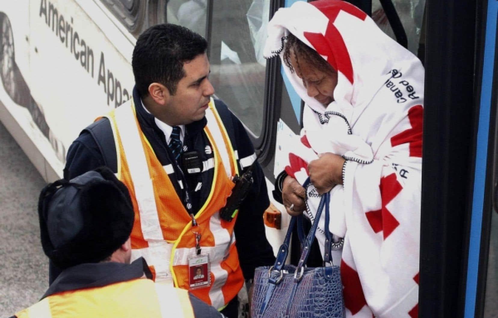 Une Haïtienne évacuée arrivant à Montréal, le 17 janvier.