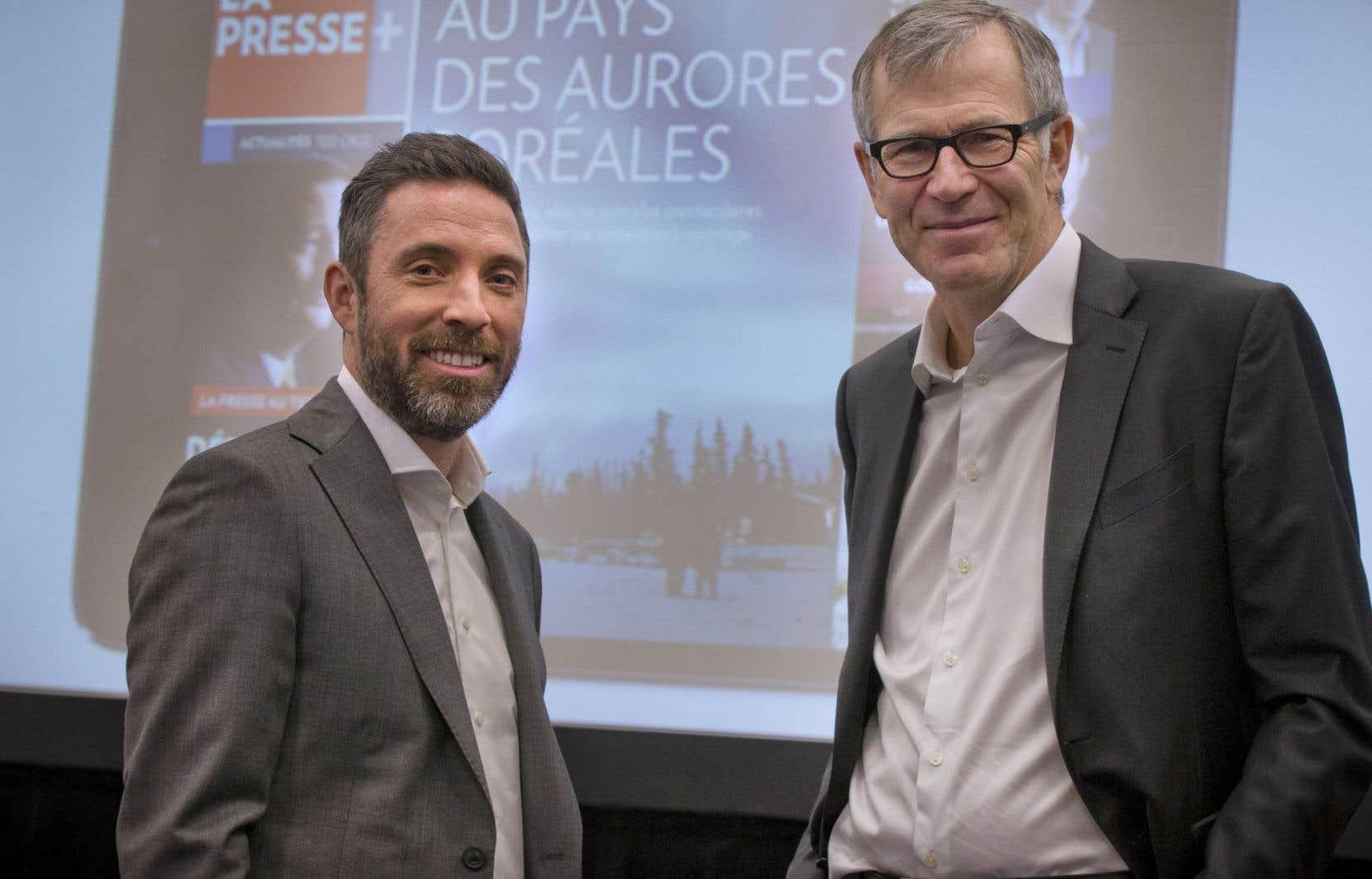 Le nouveau président de «<em>La Presse»</em>, Pierre-Elliott Levasseur, aux côtés de son prédécesseur Guy Crevier