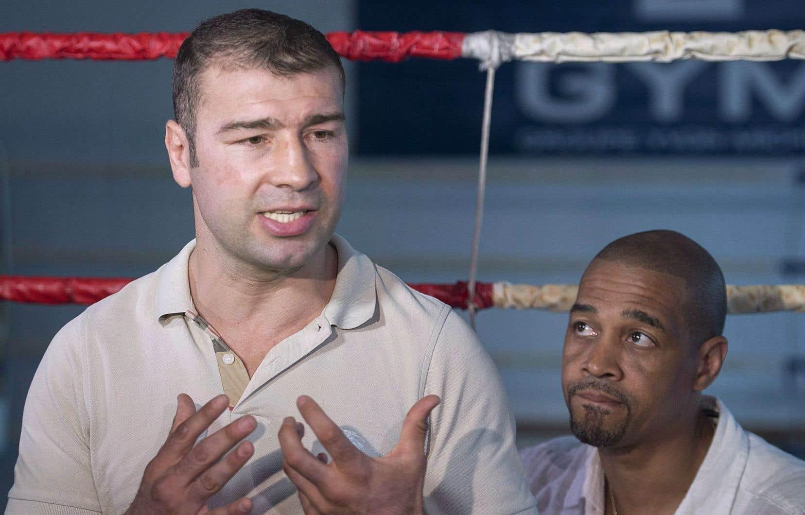 Le boxeur québécois d'origine roumaine Lucian Bute (gauche) et son entraîneur, Howard Grant, le 27 mai 2016