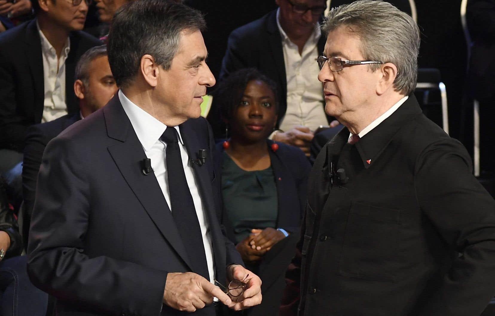 Les candidats à la présidentielle française François Fillon etJean-Luc Mélenchon