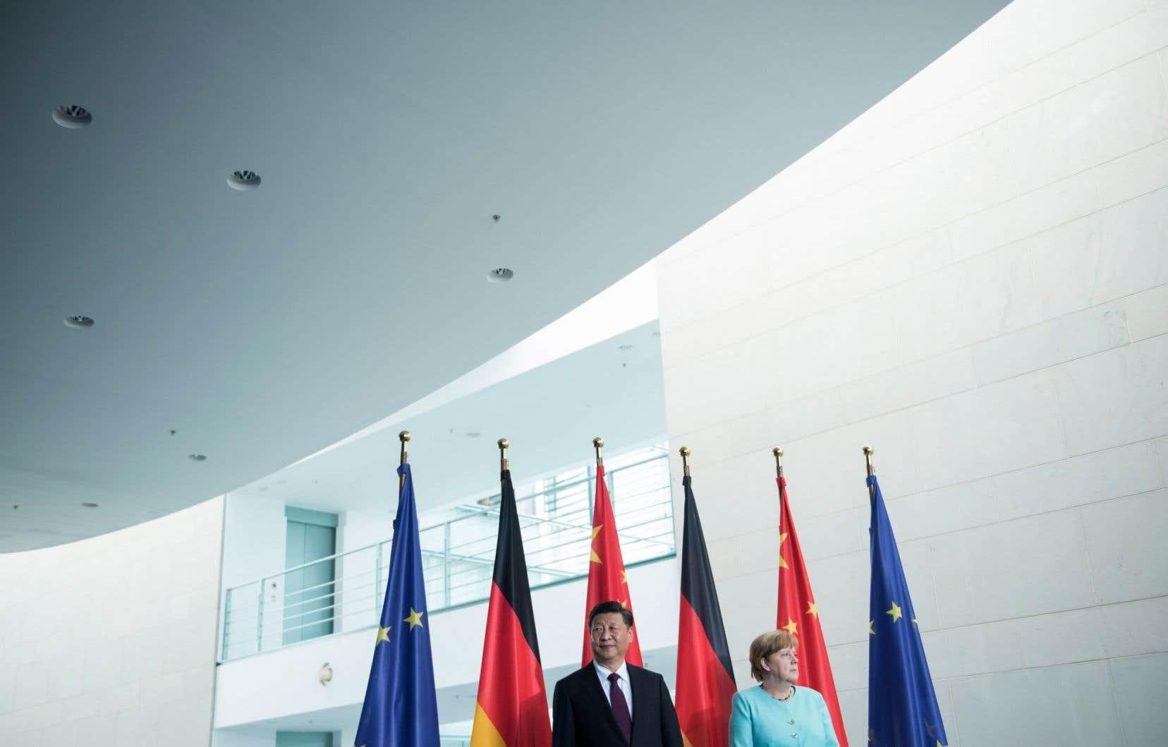 La chancelière allemande, Angela Merkel, et le président chinois, Xi Jinping, à Berlin mercredi