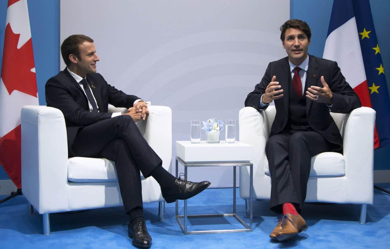Le président français, Emmanuel Macron, et le premier ministre Justin Trudeau lors d'une rencontre bilatérale lors de la journée d'ouverture du sommet du G20